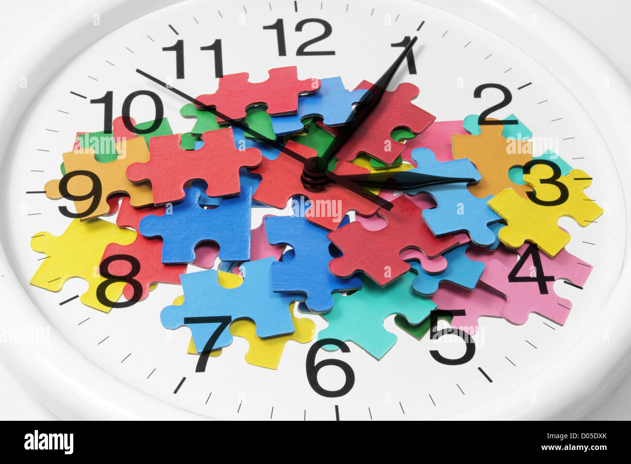 Clock and Jigsaw Puzzle Pieces - Stock Image