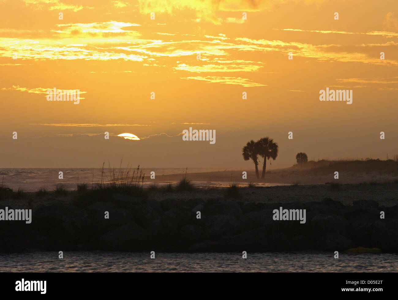 A tropical sunset on St. George Island in Florida's panhandle. - Stock Image