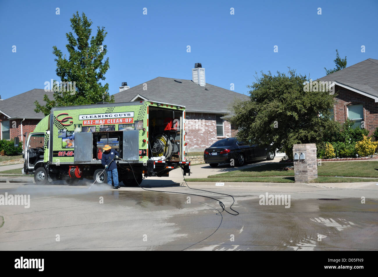 Hazmat spill cleaning on residential street, USA - Stock Image