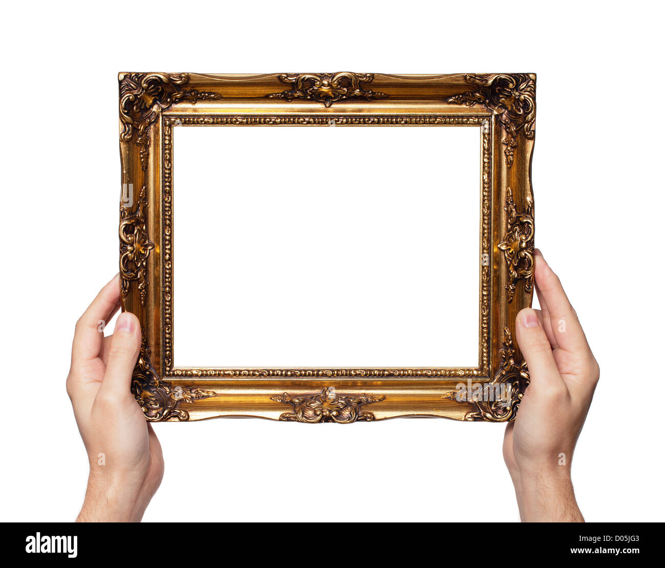 Man Holding Antique Style Golden Color Picture Frame In His Hands.