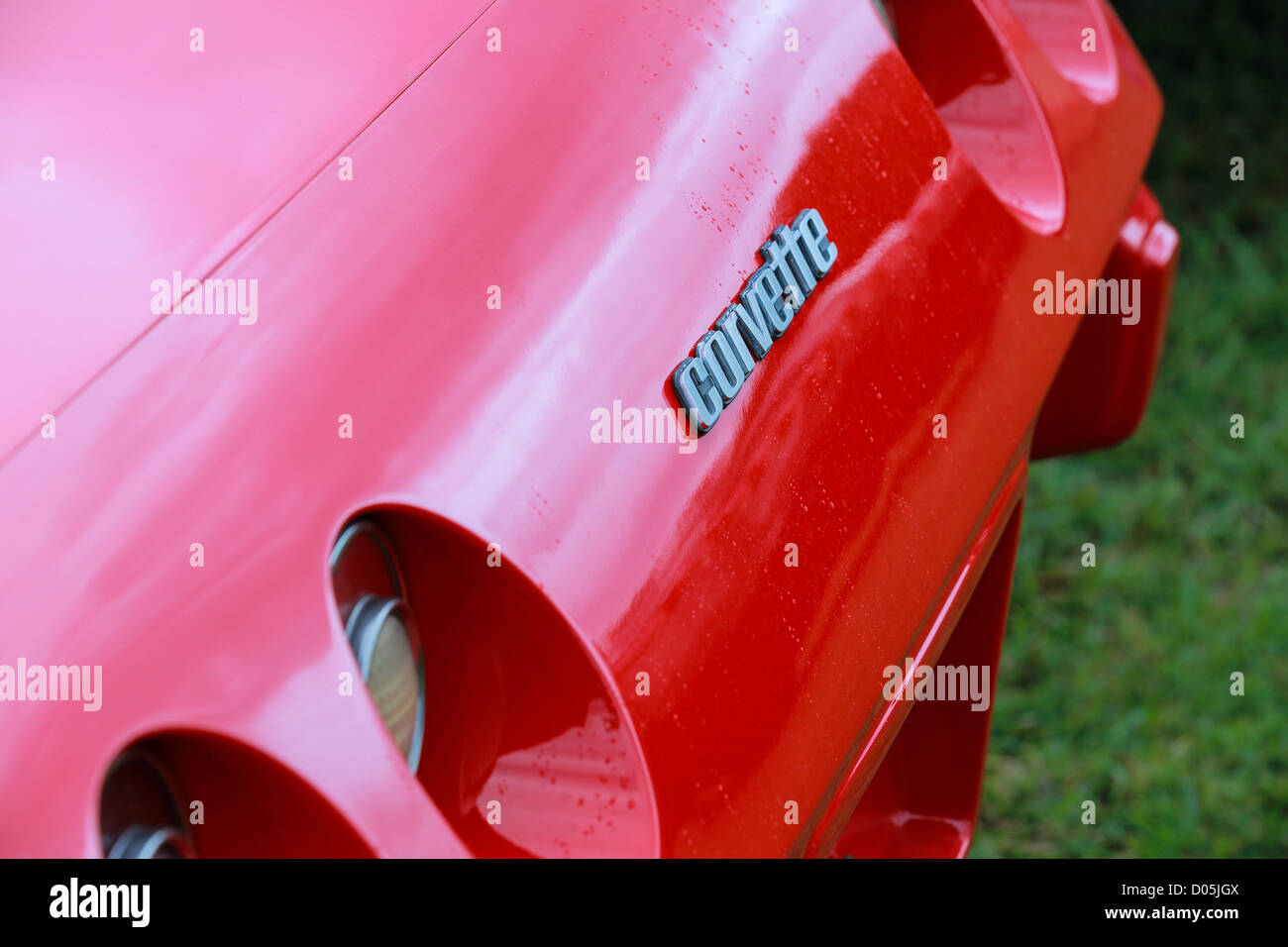 Corvette rear badge detail on red body on display at a rainy Gold Coast Car Show - Stock Image