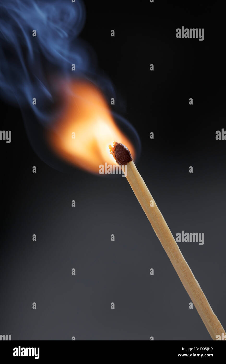 Ignition of a match stick. - Stock Image