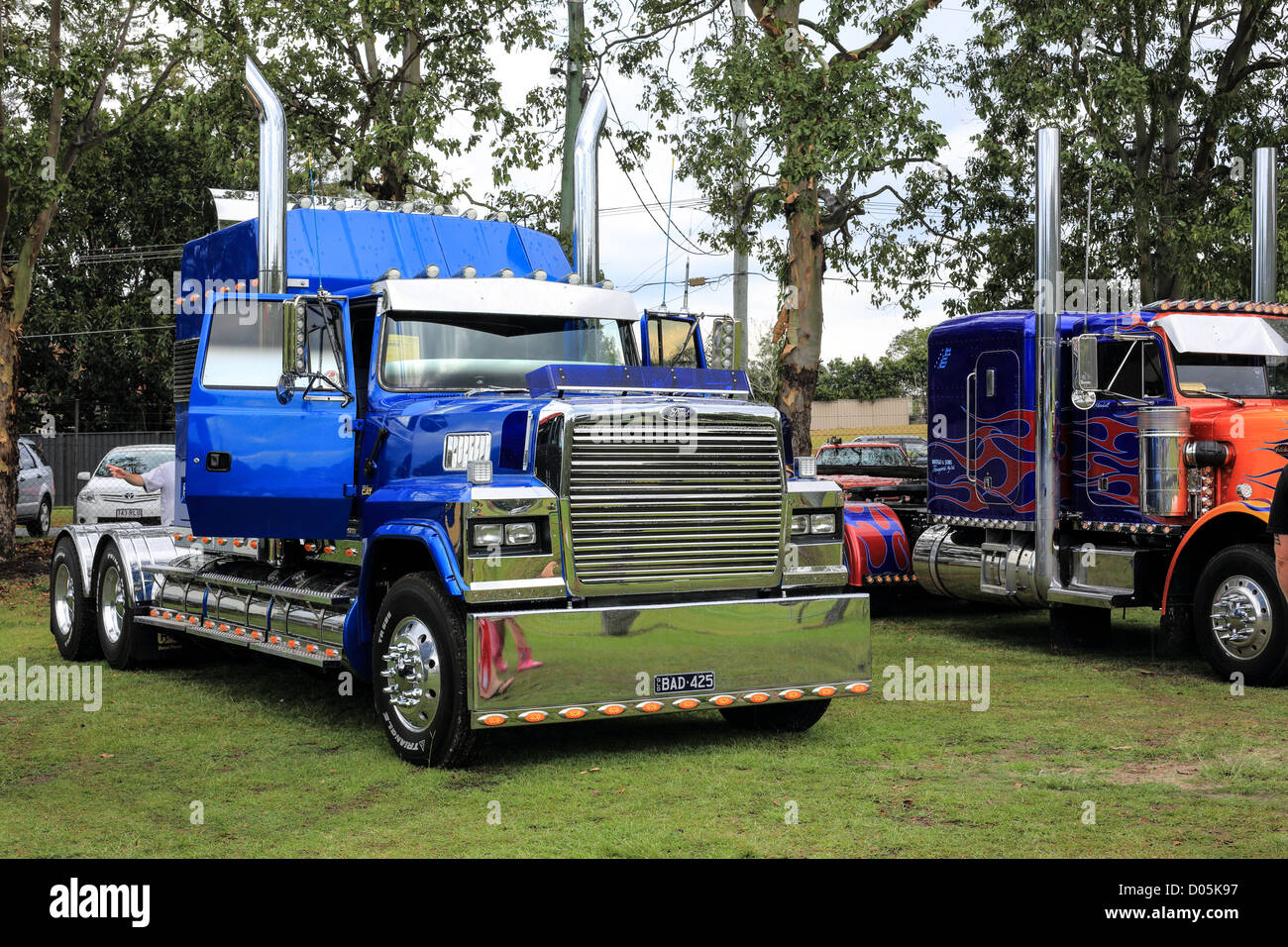 Heavy haulage truck decorated with highly polished stainless steel fittings and elegant decals on display at the - Stock Image