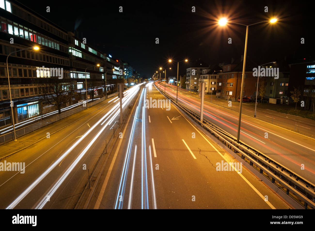Traffic trails at night in Zurich suburbs. - Stock Image