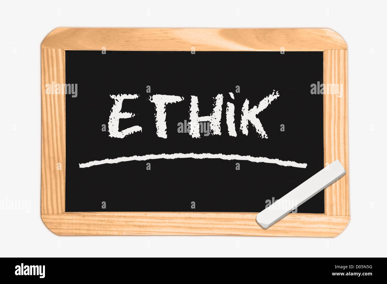 Detail photo of a Chalkboard with the German inscription ethics, white chalk lies in a corner - Stock Image