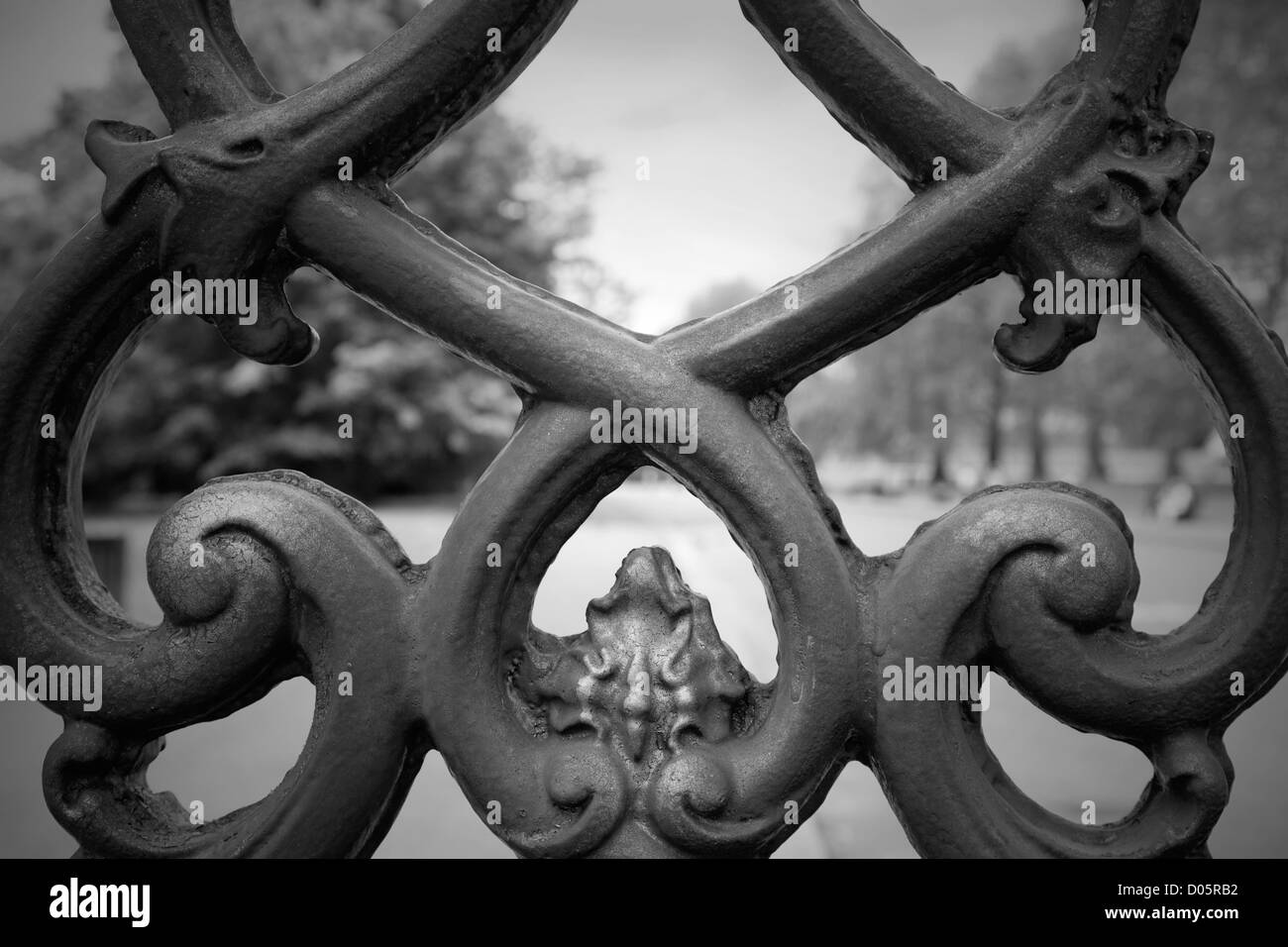 A detail of an ornamental wrought iron gate, London, UK. - Stock Image