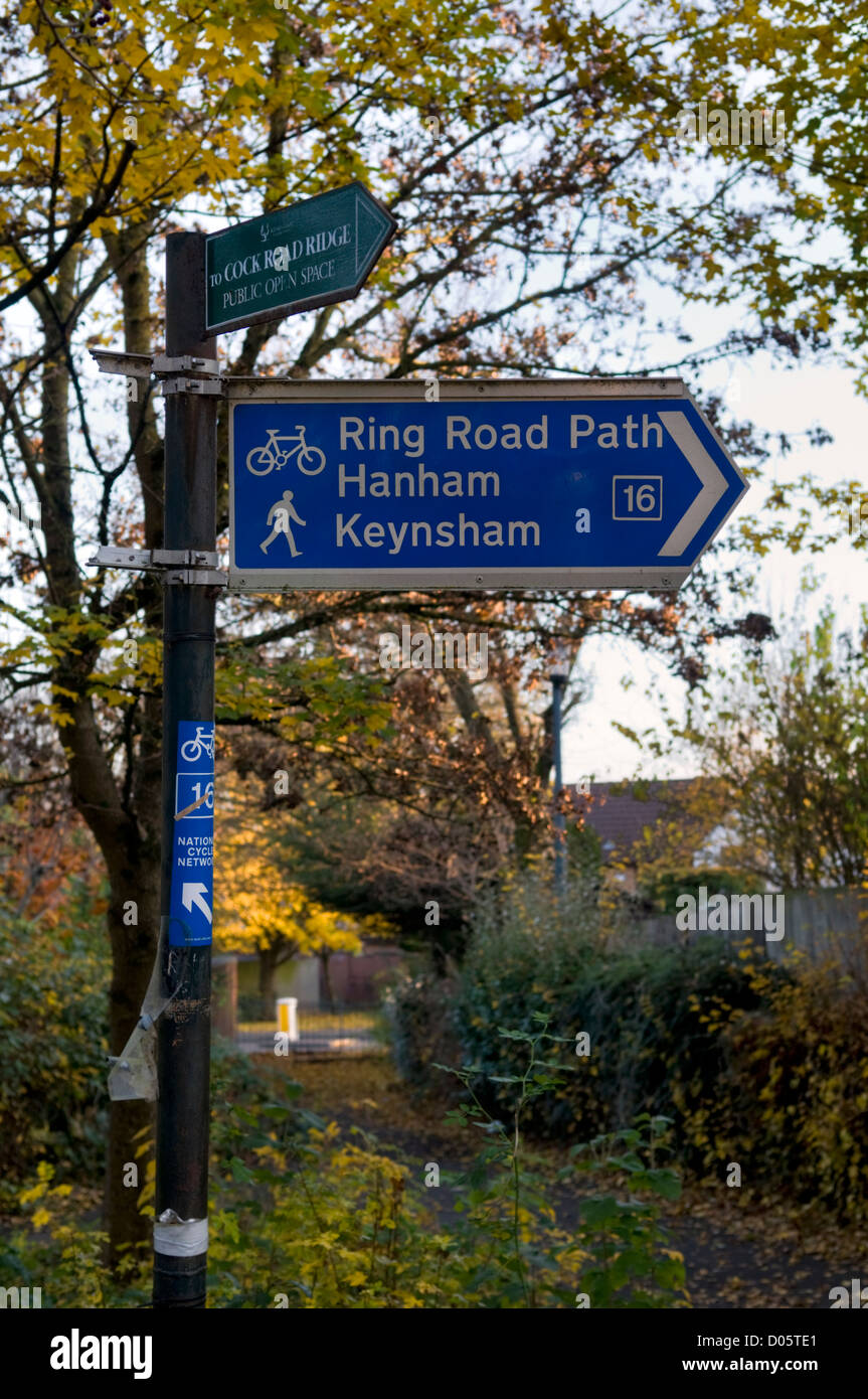 Cycle path route sign to Hanham and Keynsham in Bristol, UK with autumn colours behind - Stock Image