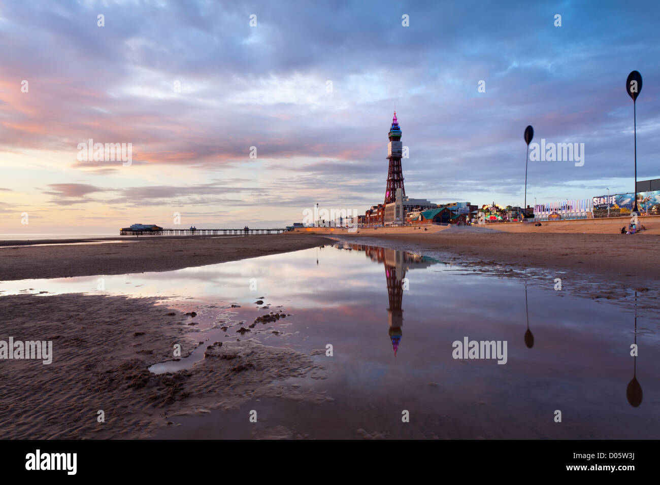 Blackpool Tower and beach at sunset during the summer holiday season Stock Photo