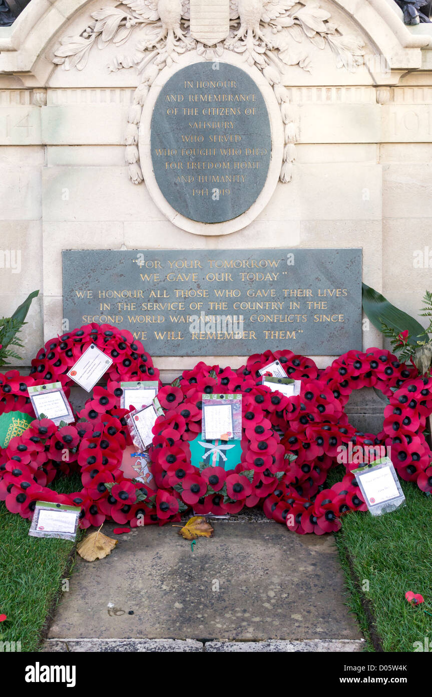 Wreathes made of Poppies placed on UK war memorial - Stock Image