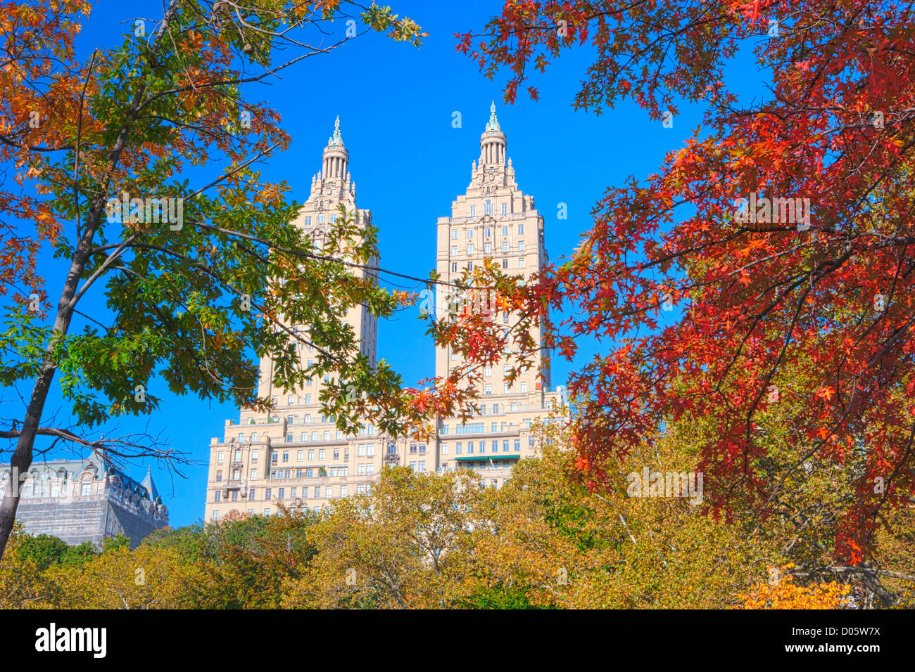 San Remo's twin towers surrounded by Autumn colors in Central Park, New York, USA - Stock Image