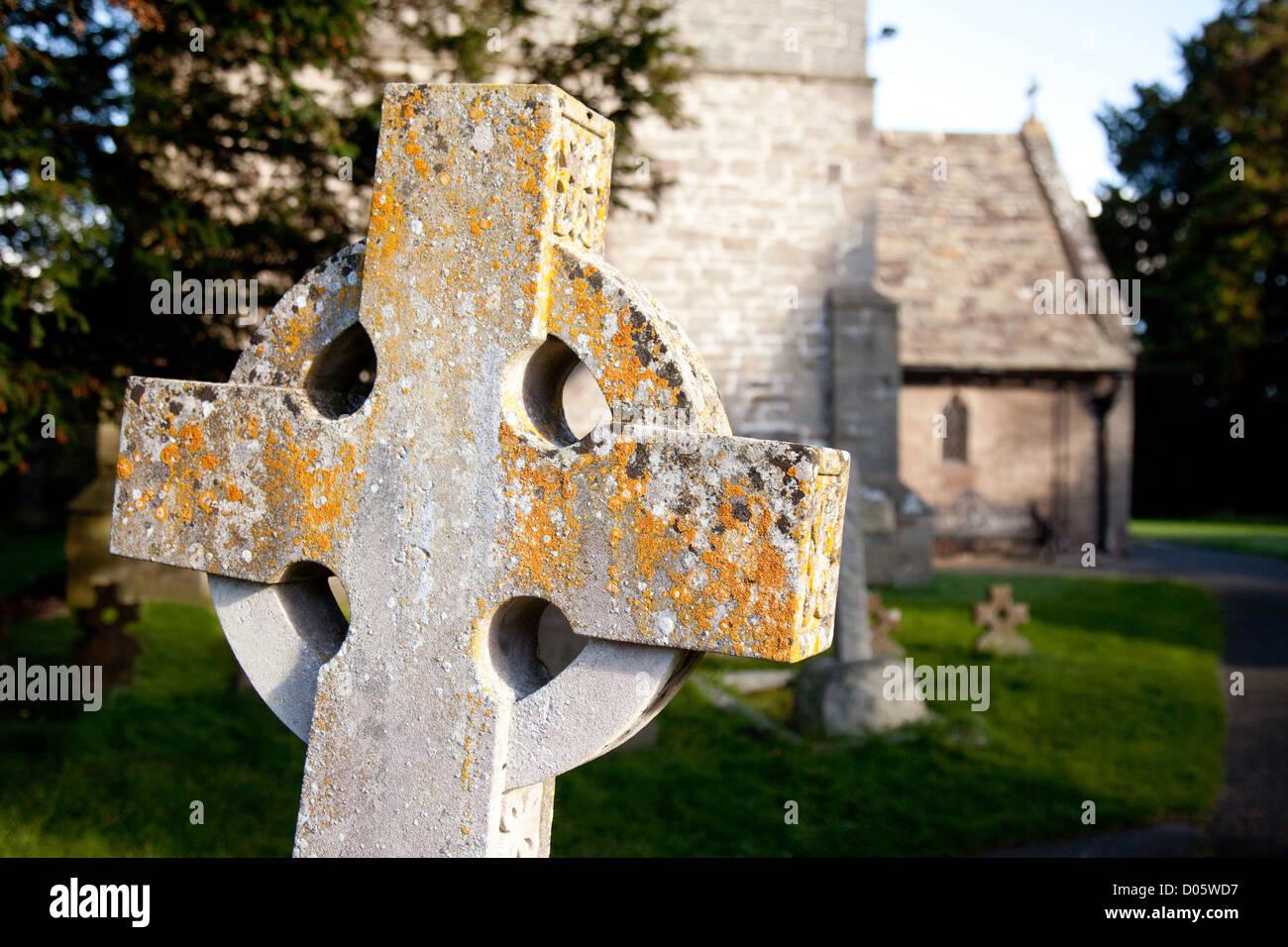 A cross in the churchyard, Church of St Mary the Virgin, Eardisland, Herefordshire UK - Stock Image