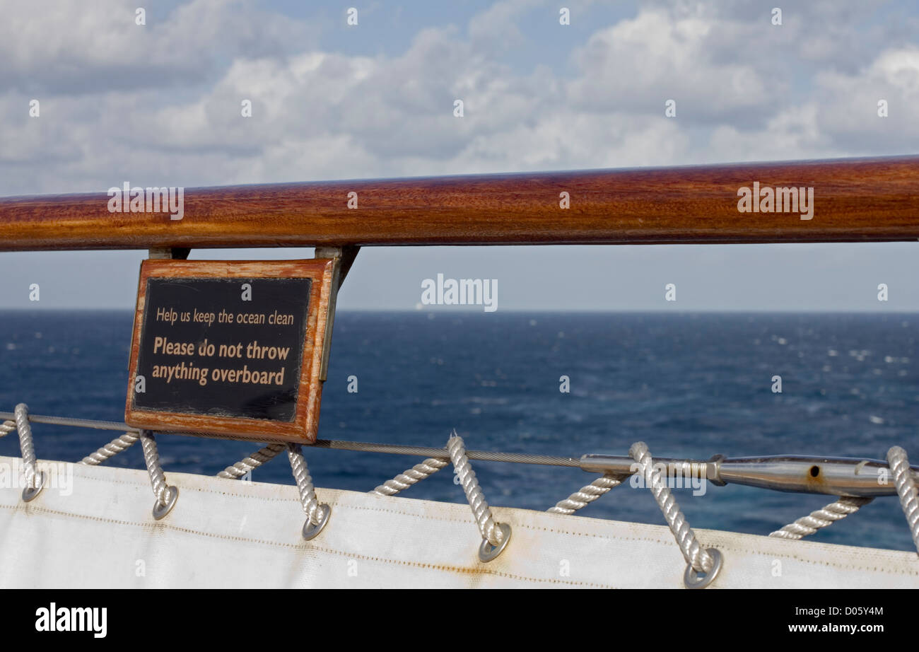 Notice at the stern of the Cunard cruise ship Queen Mary 2 advising not to pollute the sea by throwing anything - Stock Image