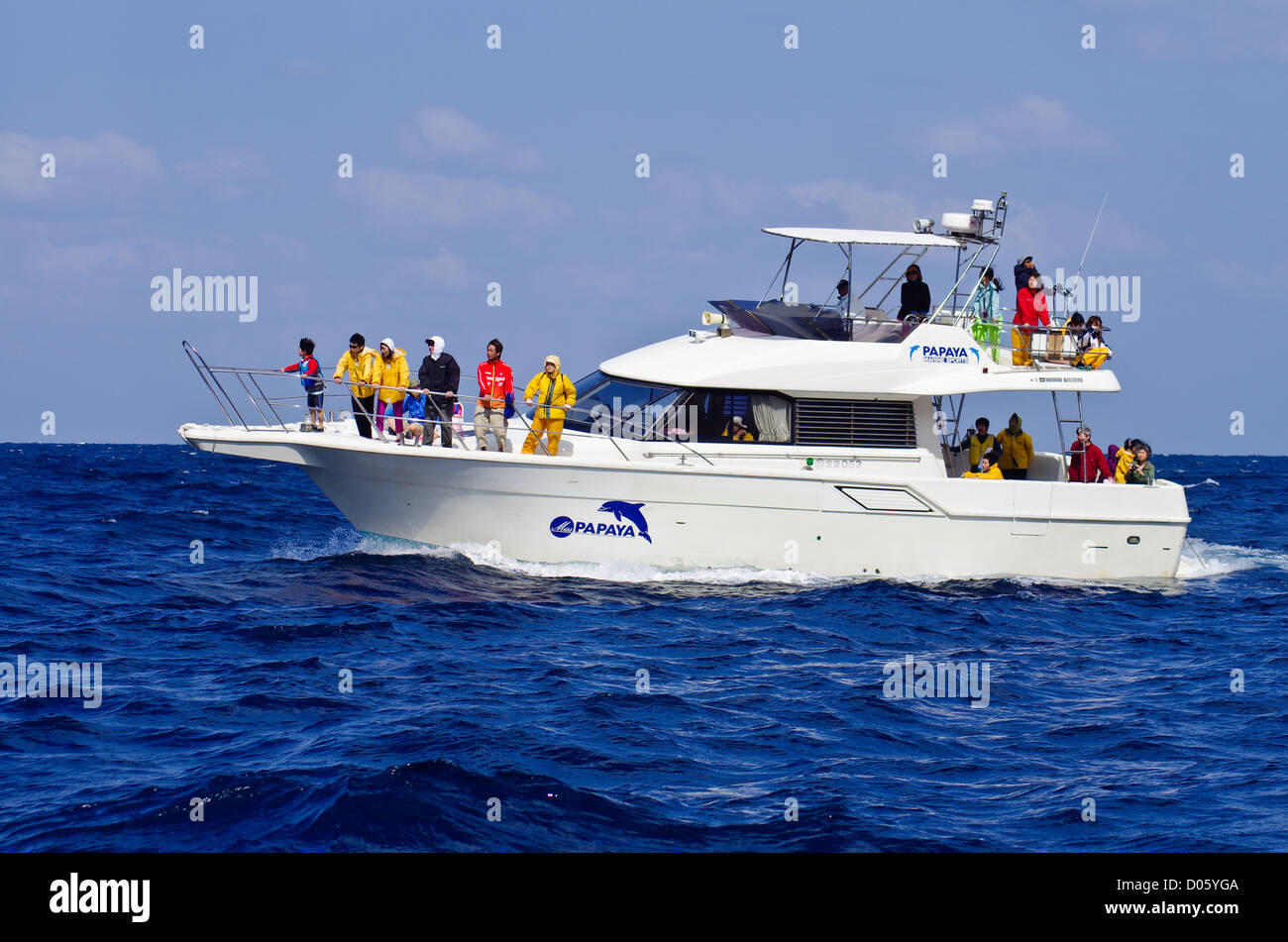 Dolphin and Whale Sightseeing Boat with Passengers cruising around Chichijima, Ogasawara Islands, Tokyo, Japan - Stock Image
