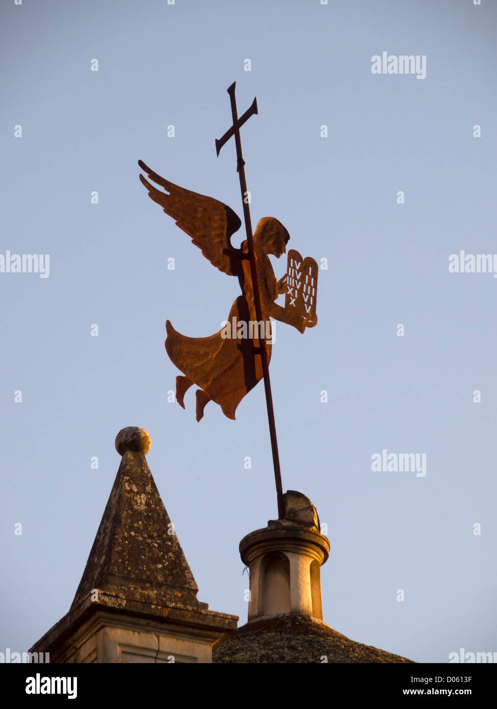 Angel sillhouette weather vane on top of a church - Stock Image