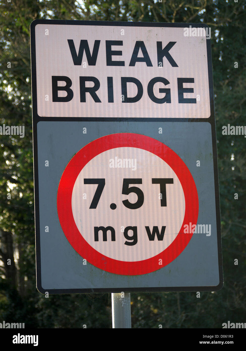 A road sign warning of a weak bridge ahead - Stock Image