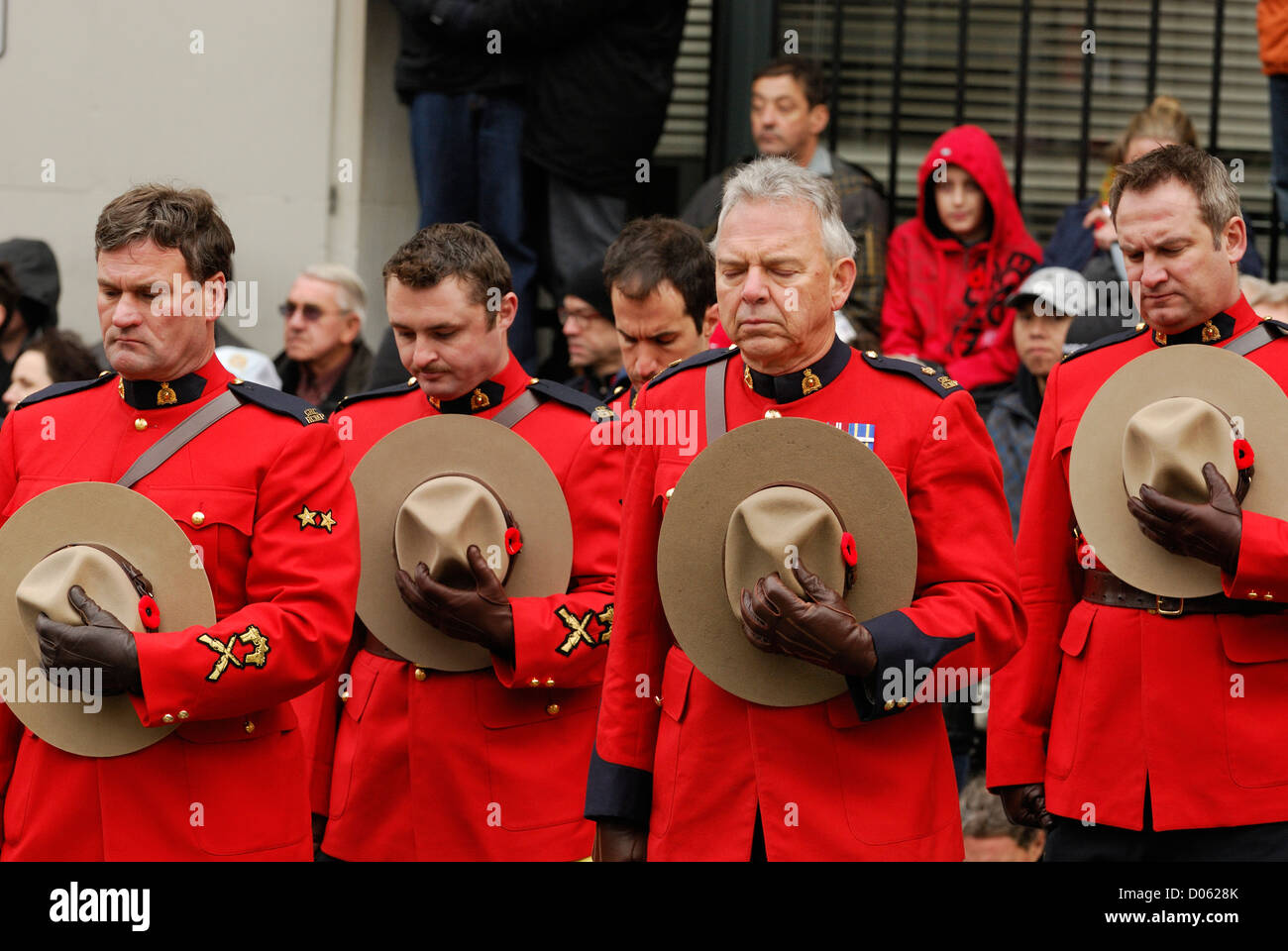 R.C.M.P. in full red serge hats lowered attending a remembrance ceremony  in Vancouver. Stock Photo