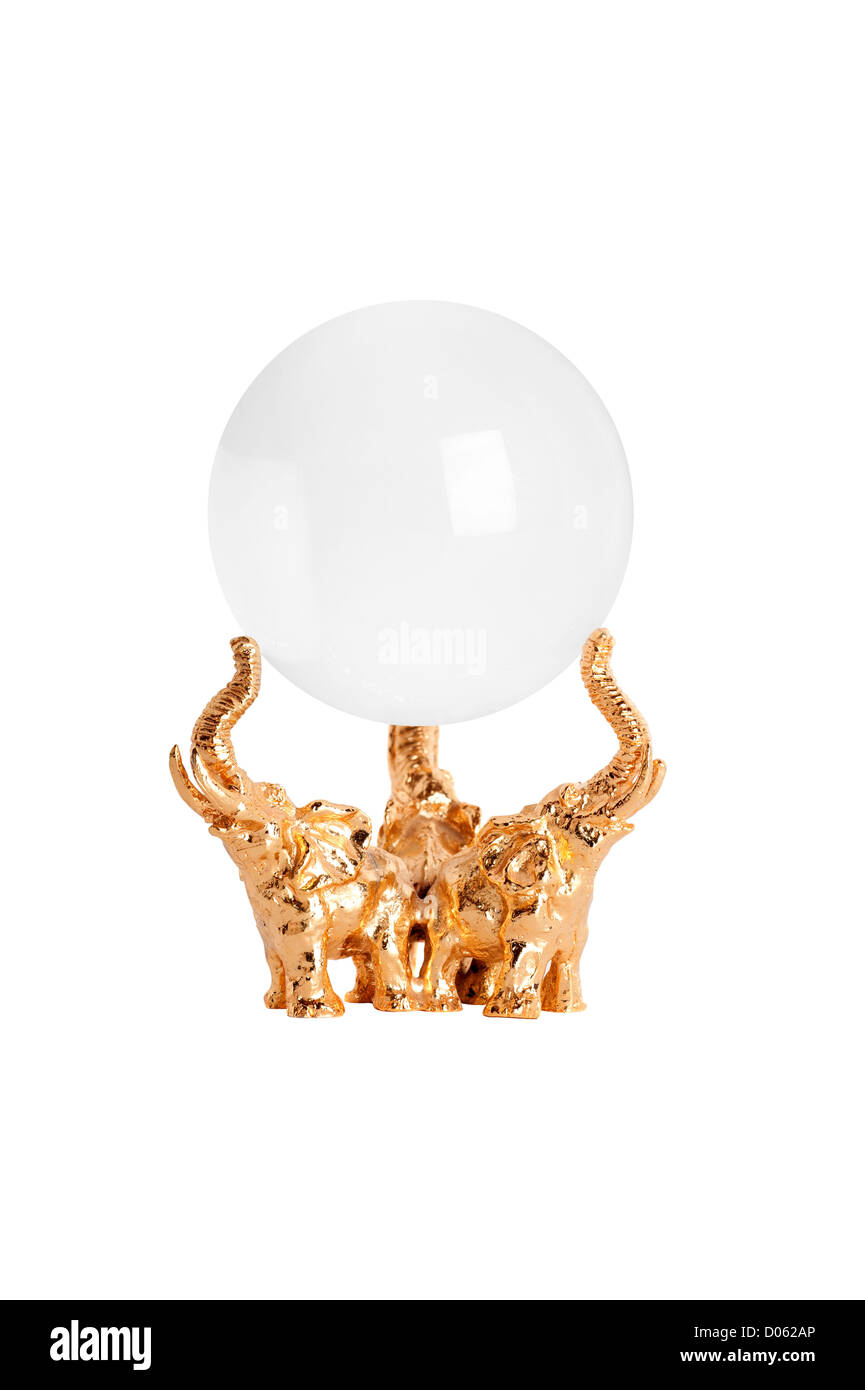 A real crystal ball on a gold elephant stand isolated on white. - Stock Image