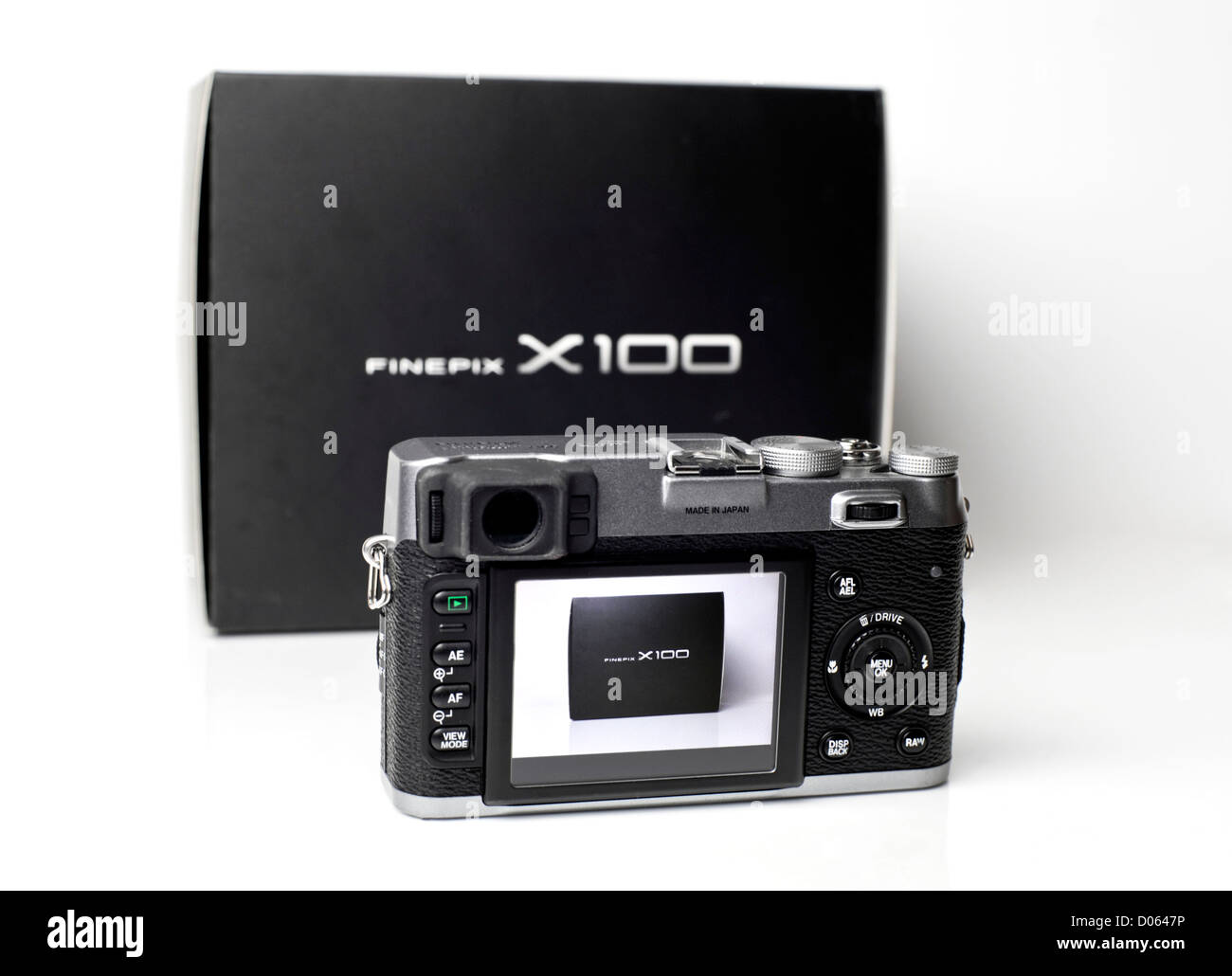 Fugi Fine Pix X100 DSLR camera front view with after market lens hood - Stock Image