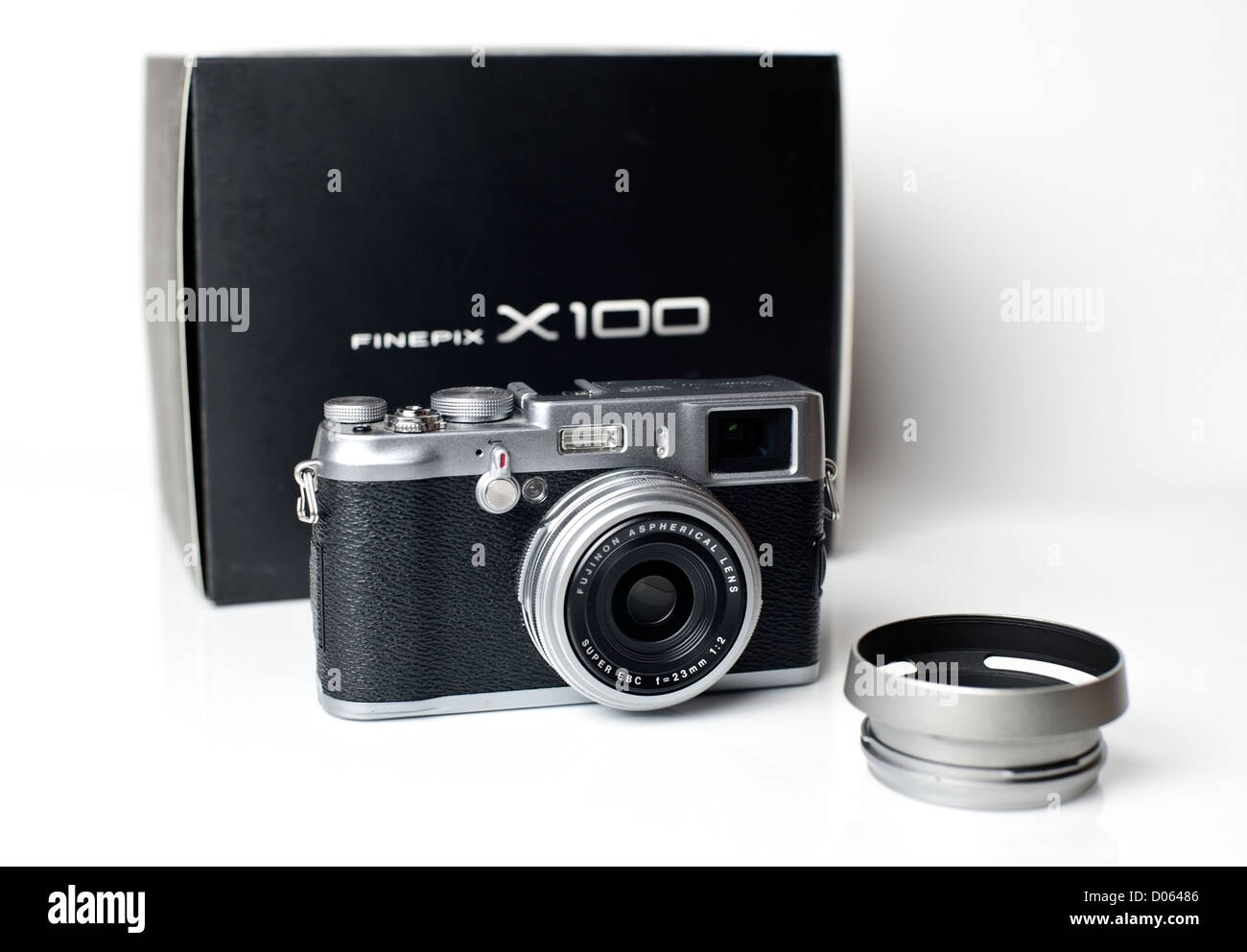 Fugi Fine Pix X100 camera front view with after market lens hood - Stock Image