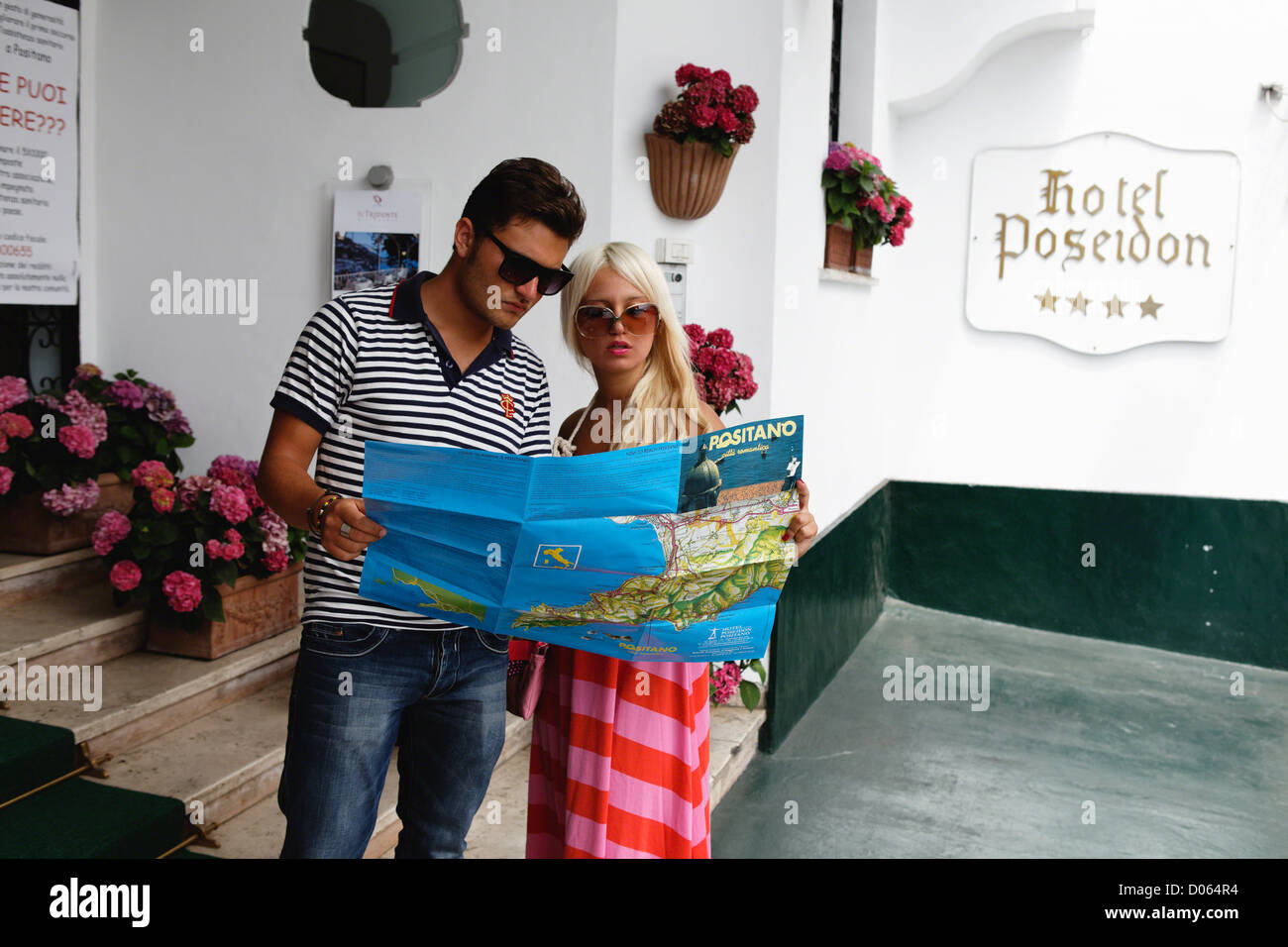 Young Couple Looking at a Map for Directions, Positano,Campania, Italy - Stock Image