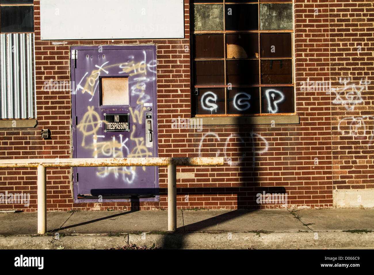Old factory with graffiti - Stock Image