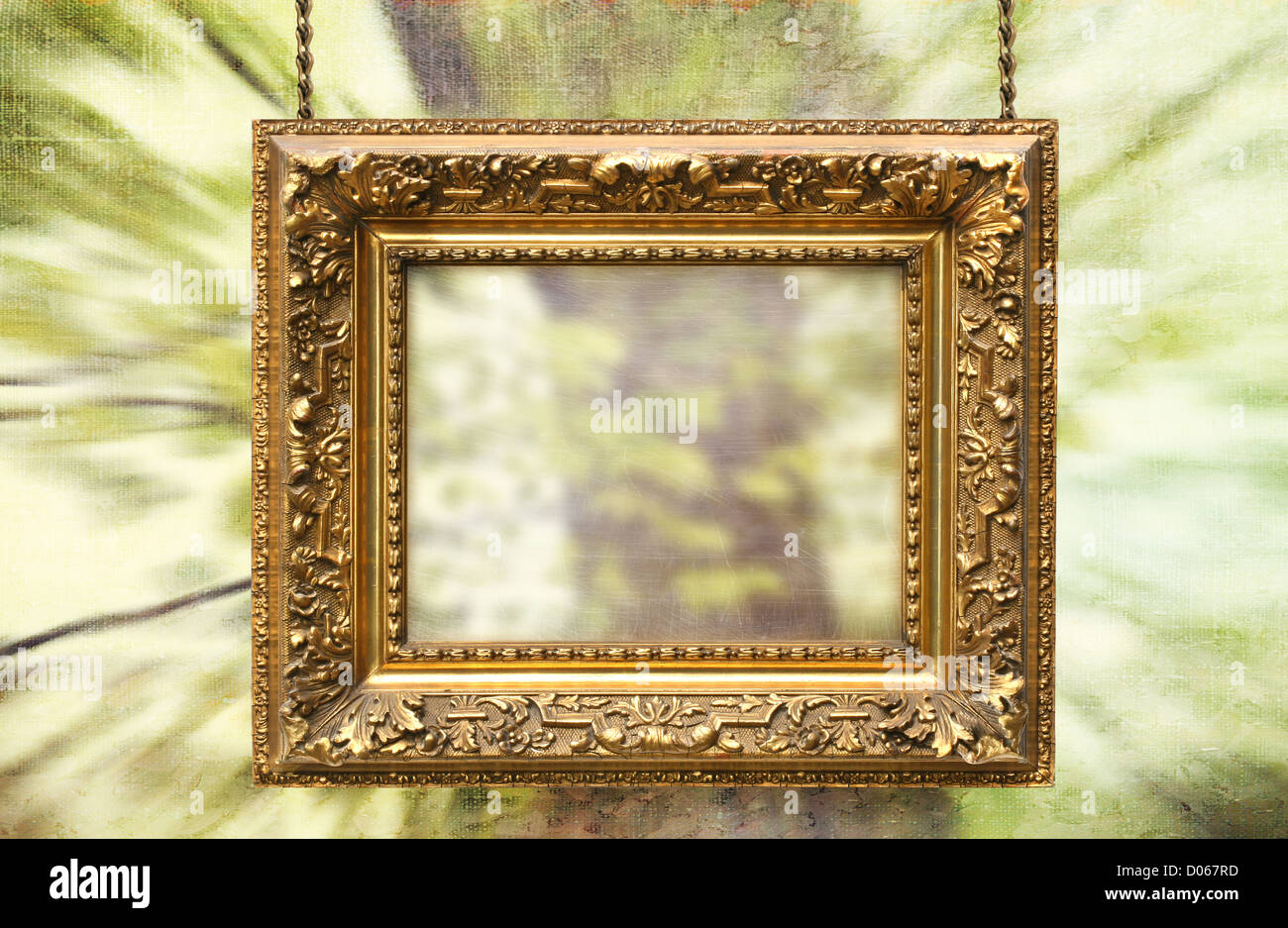 Gilded frame hanging with spring abstract background - Stock Image
