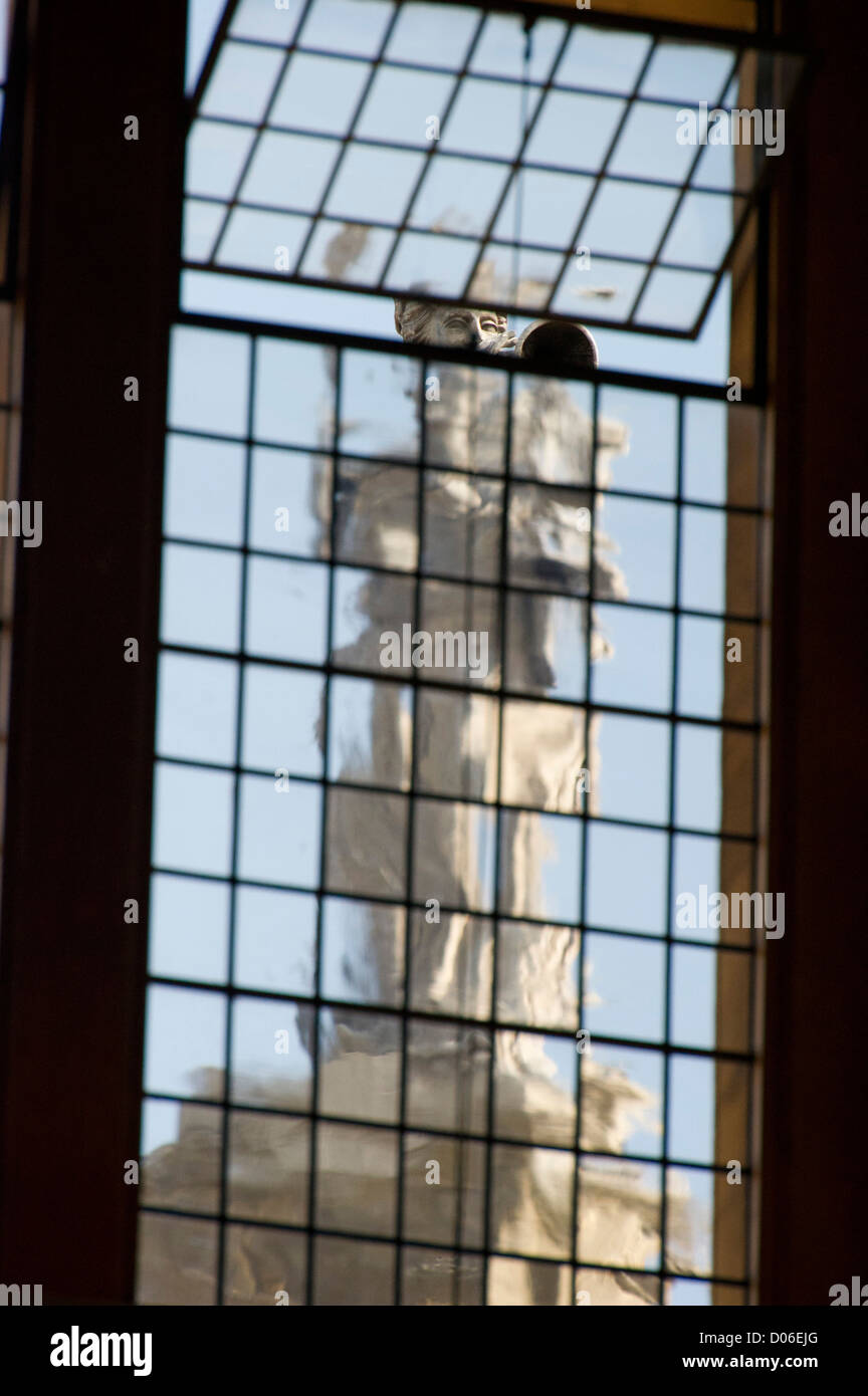 A statue on the Clarendon building seen through a window of the Sheldonian Theatre Stock Photo