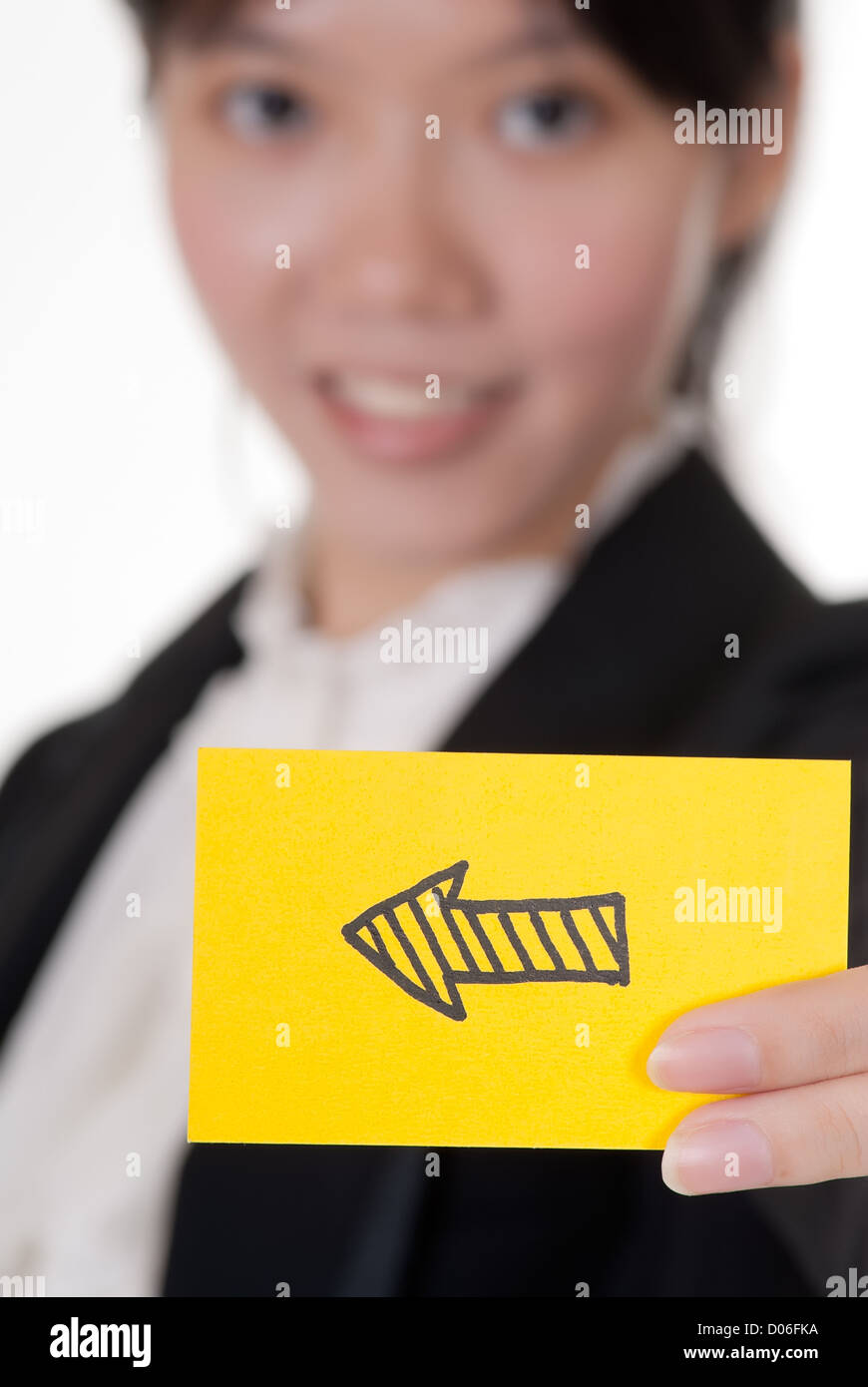 Left arrow on business card holding by Asian businesswoman Stock ...