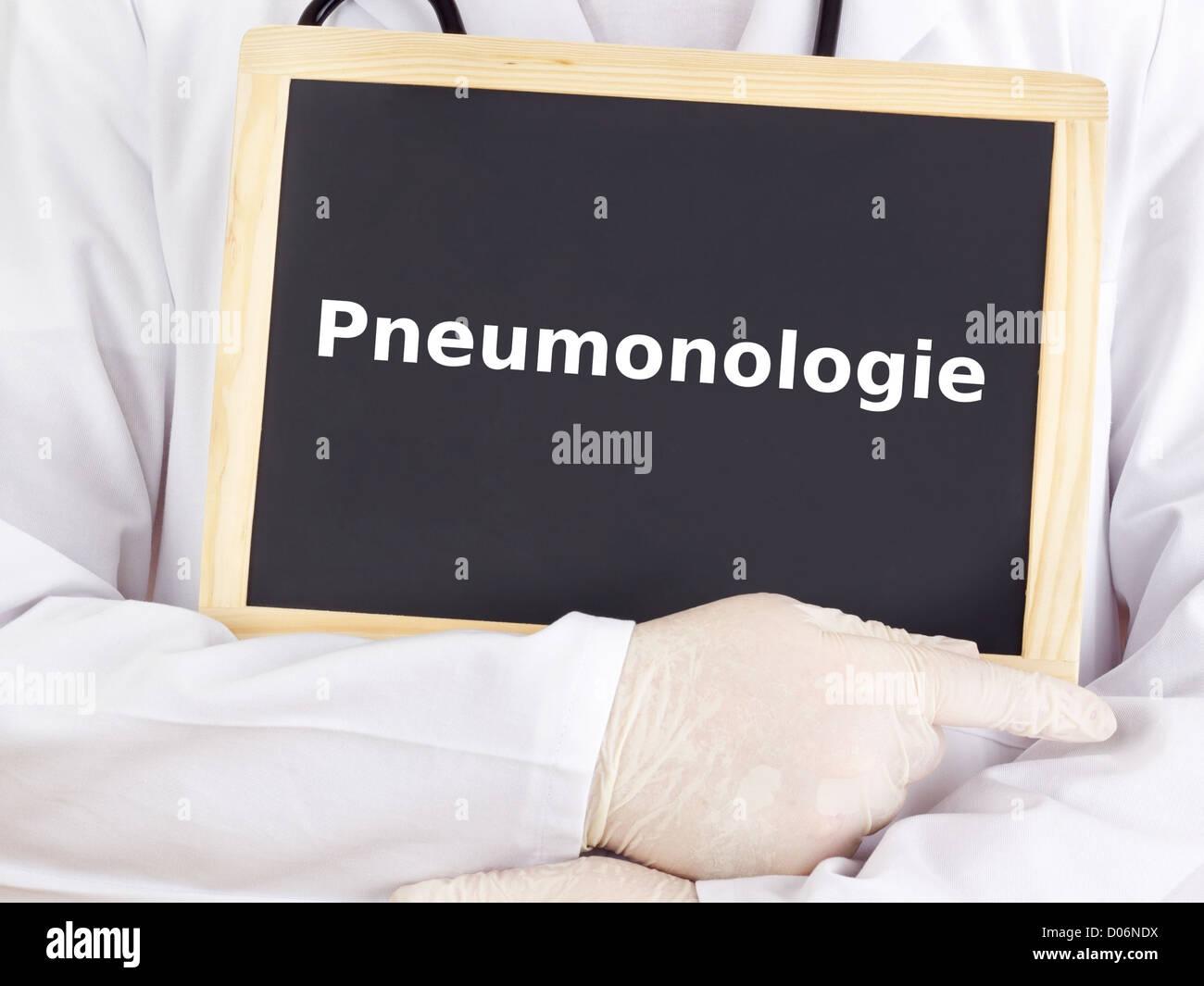 Doctor shows information on blackboard: pneumology - Stock Image