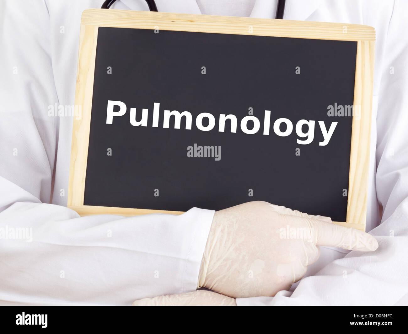 Doctor shows information on blackboard: pulmonology - Stock Image