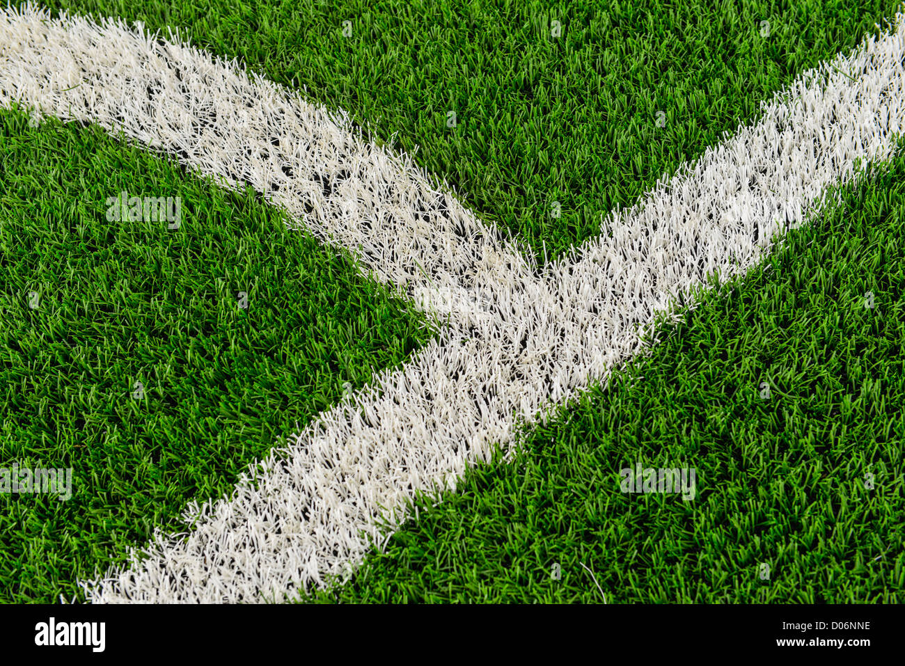 The touch line on a football pitch made of third generation astro turf. - Stock Image