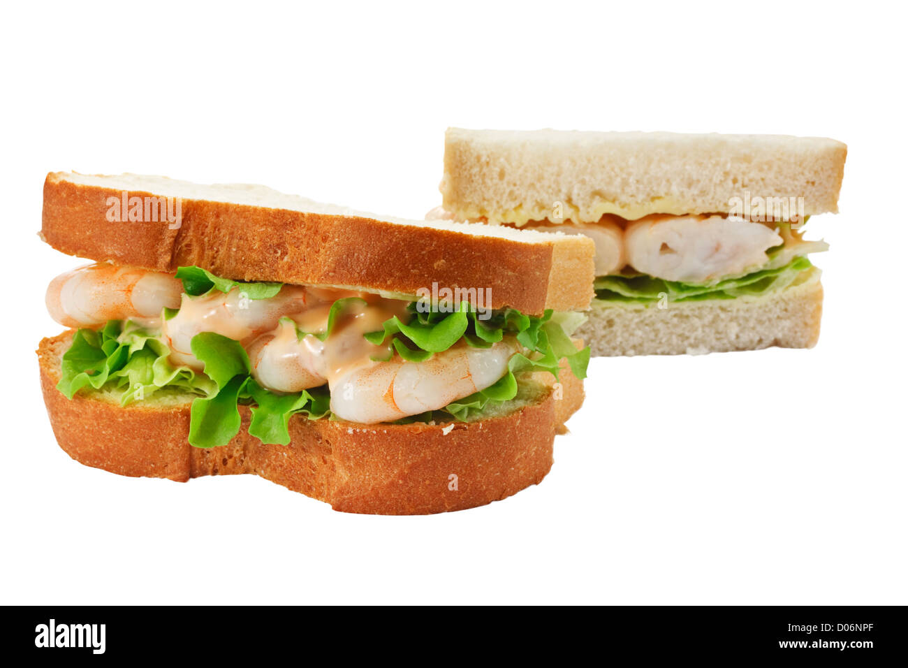 A king prawn salad sandwich with seafood sauce made with freshly sliced bread - Stock Image