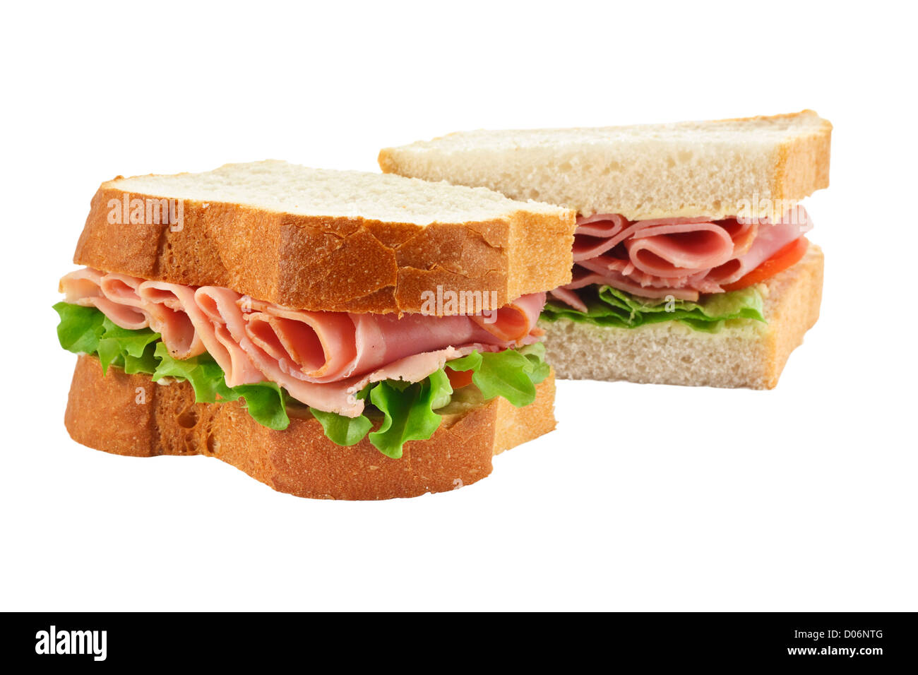 A ham salad sandwich made with freshly sliced bread cut in half with focus on the filling - Stock Image