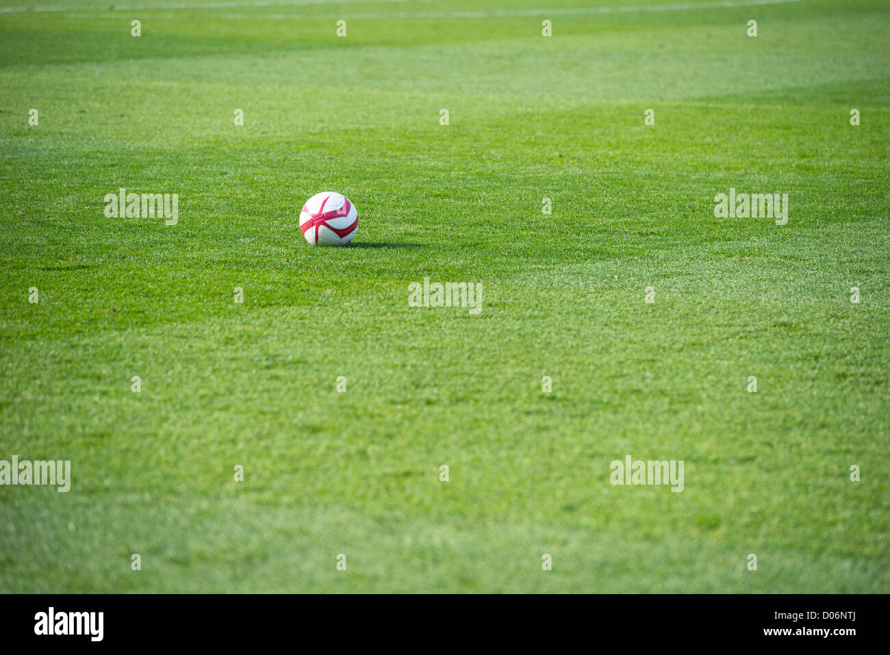 Football on a football pitch. - Stock Image