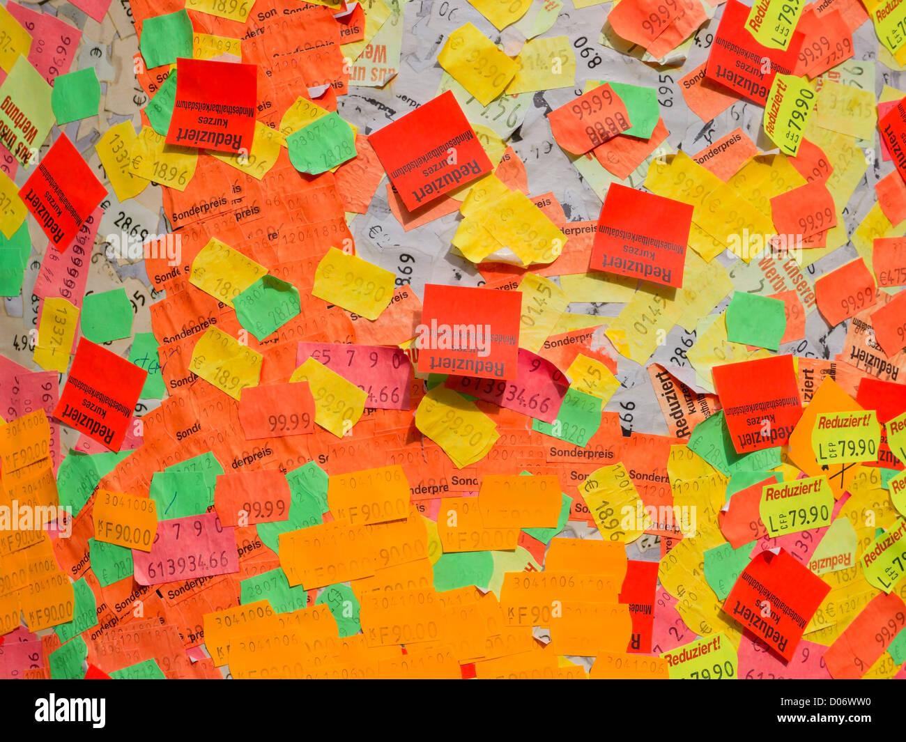 Hundreds of colourful price stickers forming a exhibit of modern art on the outside of a building in Hannover, Germany. - Stock Image