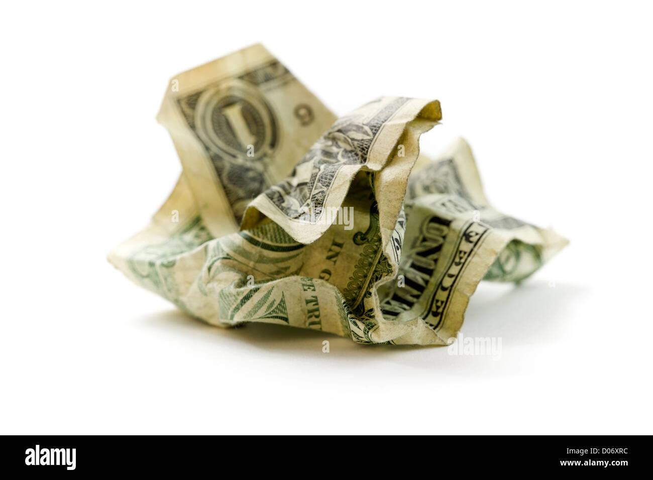 Crumpled Dollar on white - Stock Image