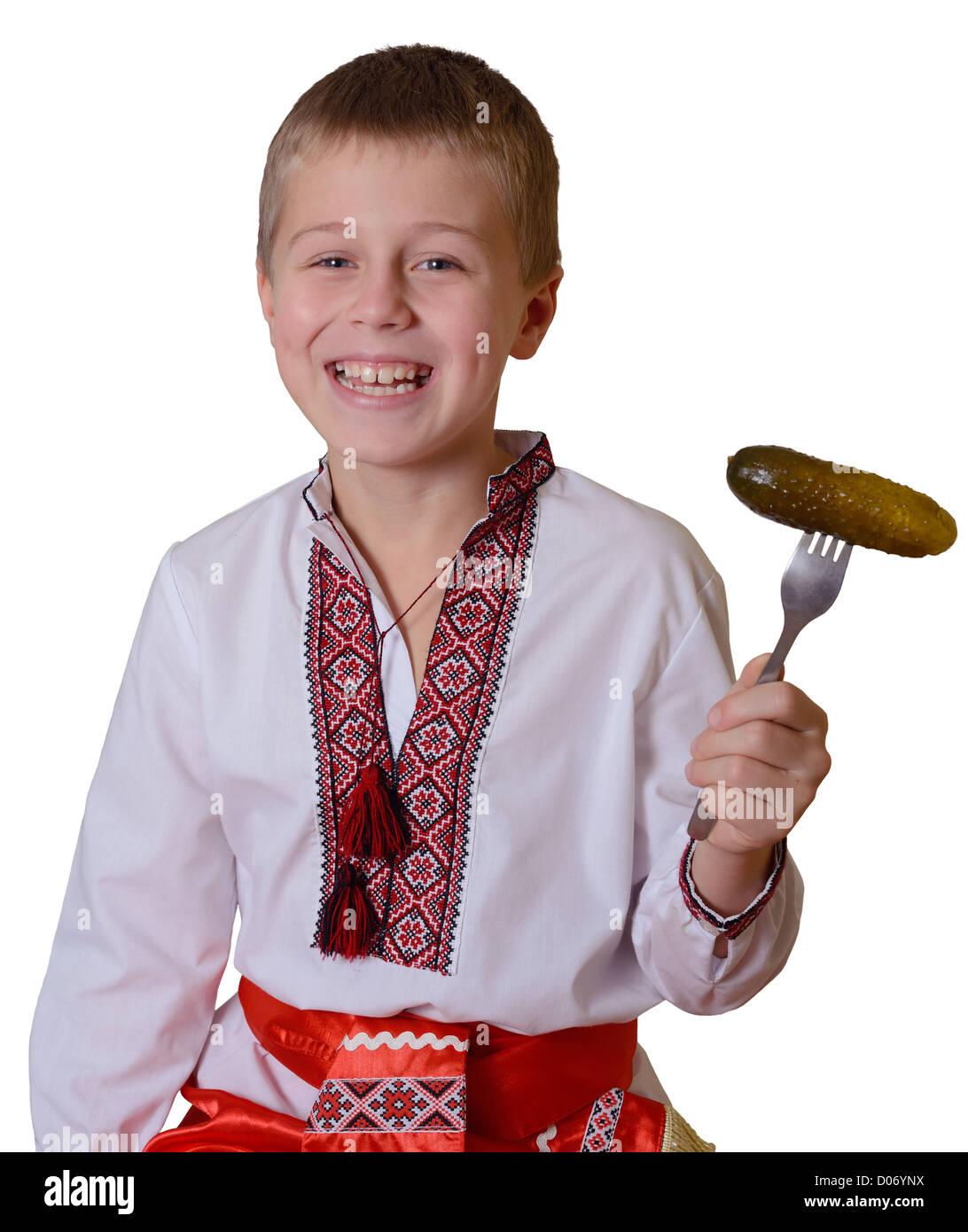 smiling slavic boy with fork - Stock Image