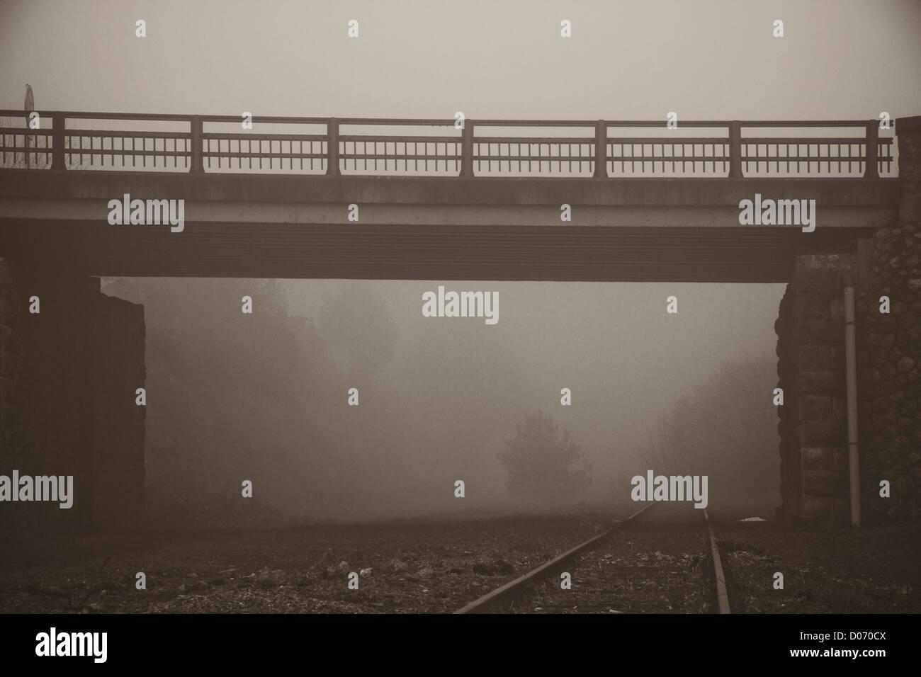 Mist over railway track and bridge. - Stock Image