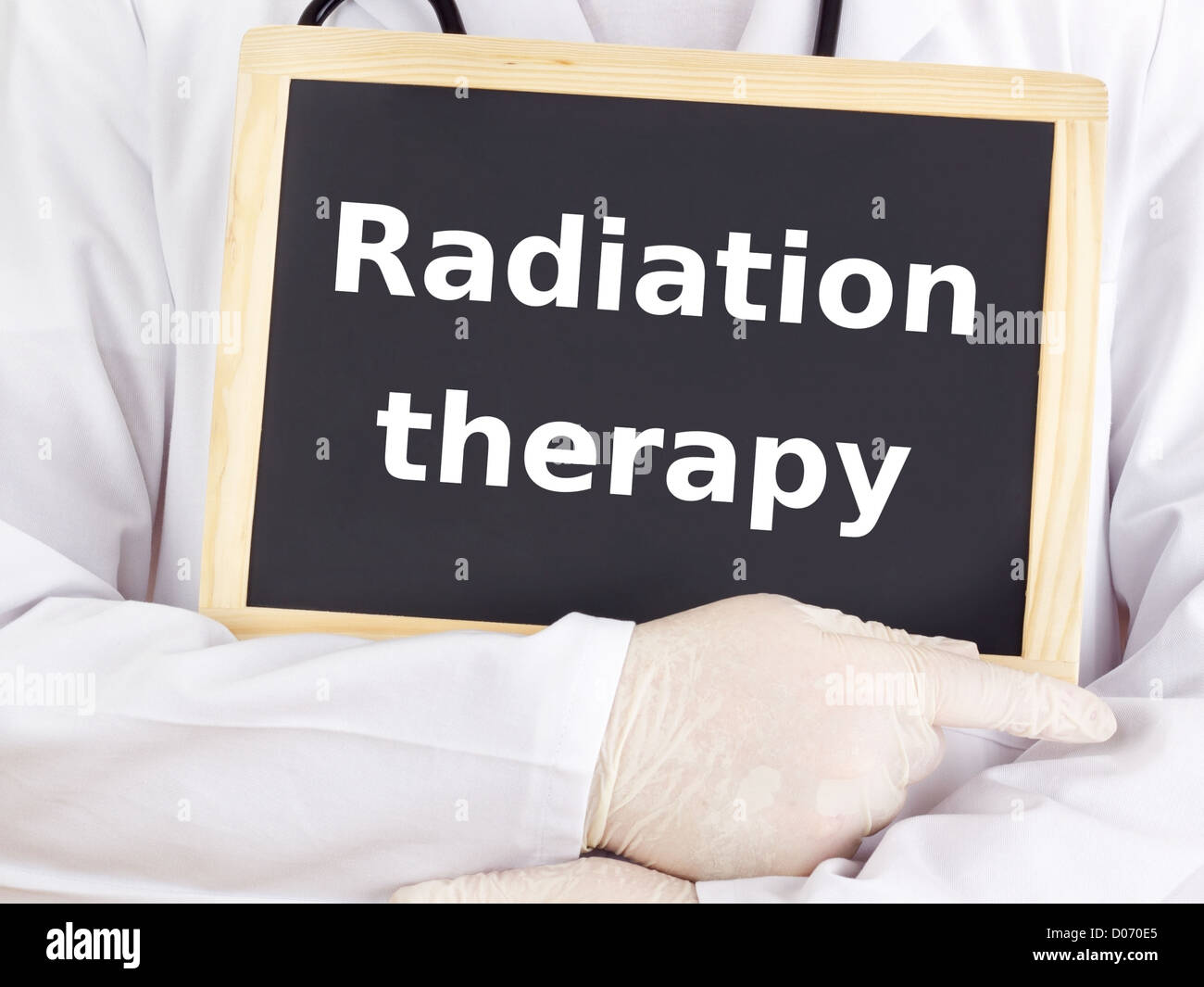 Doctor shows information: radiation therapy - Stock Image