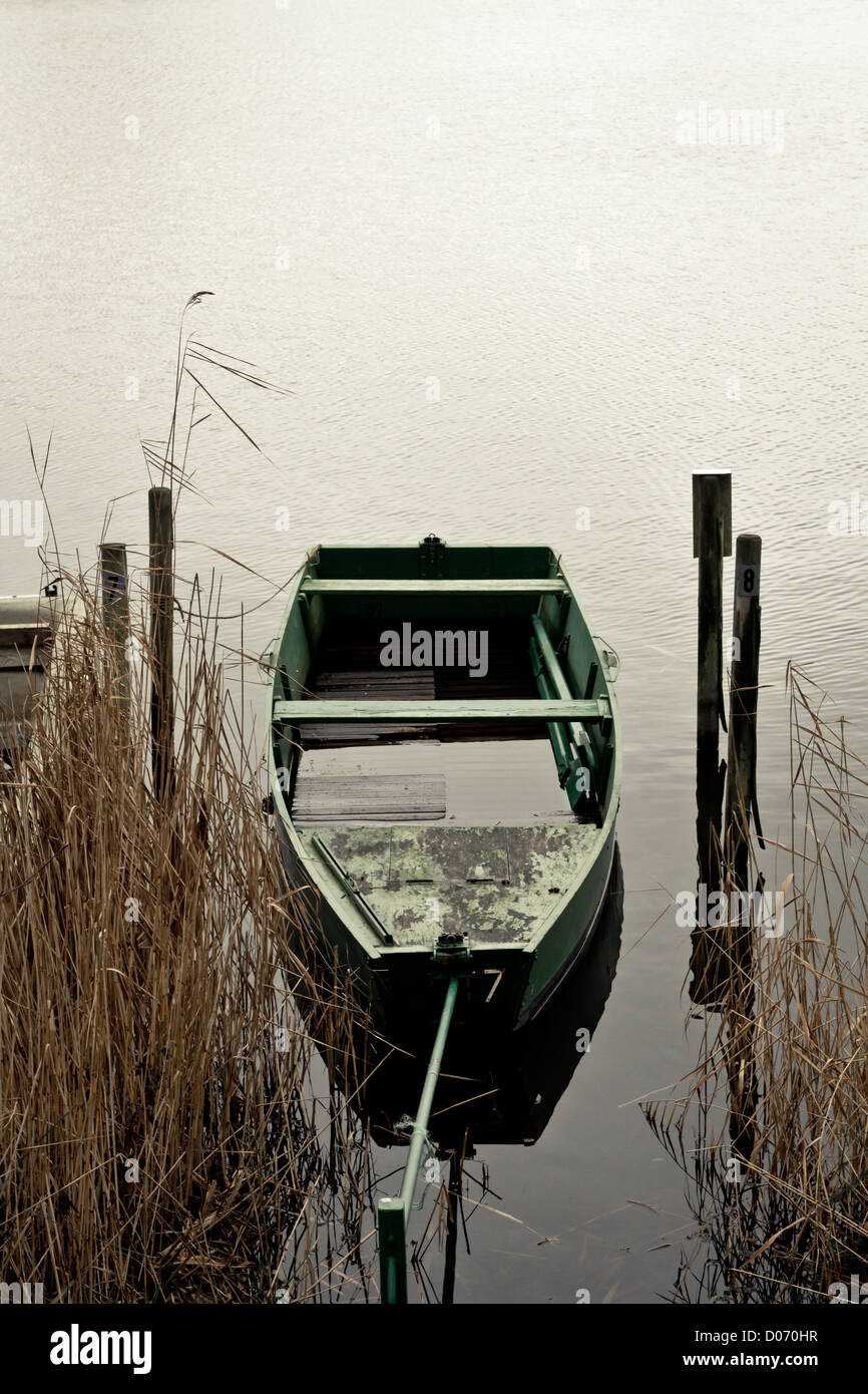 Empty boat moored on lake, France, Europe. - Stock Image
