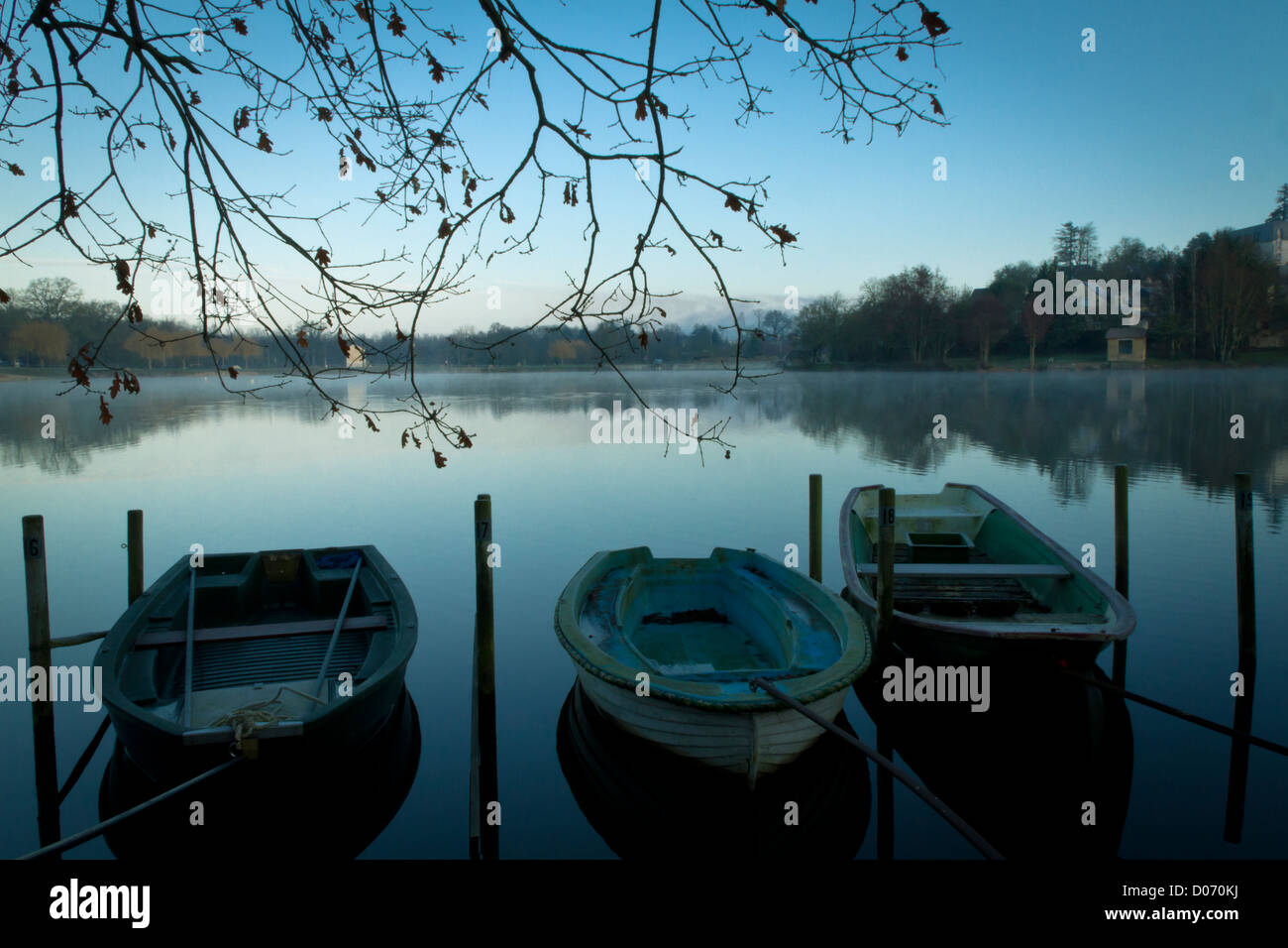 Empty boats moored on lake in countryside, France, Europe. - Stock Image