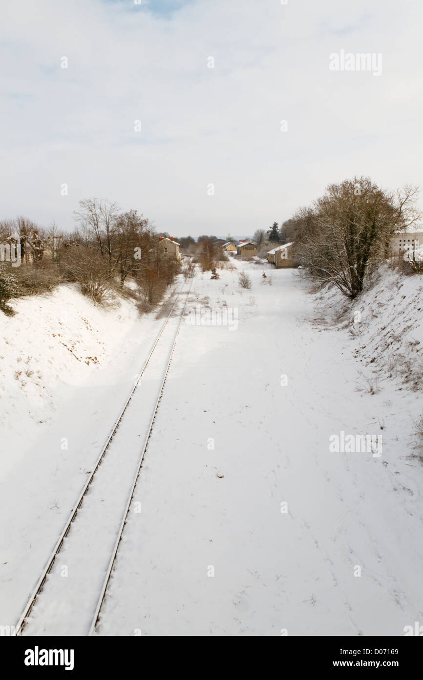 Railway tracks through winter countryside, France, Europe. - Stock Image