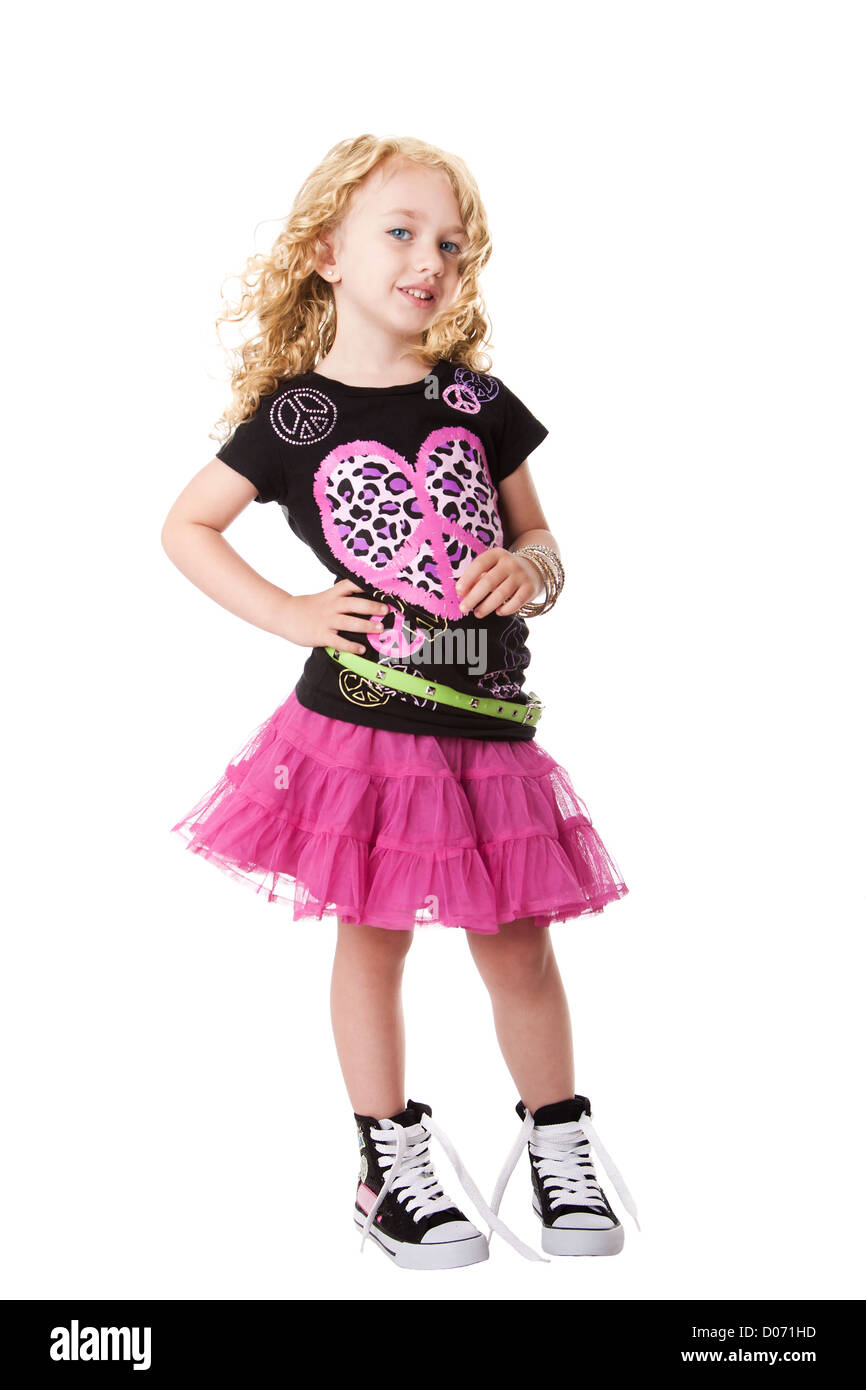 Happy smiling child girl in fashion rock and roll outfit shirt and skirt  with attitude expression, isolated.
