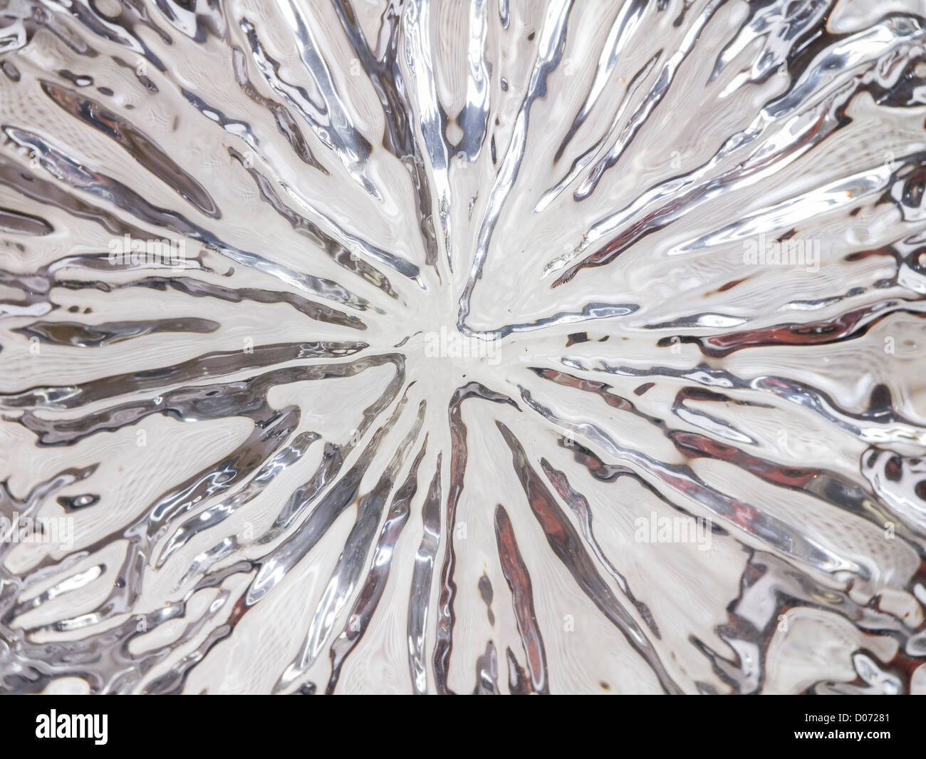 The pattern at the bottom of a lead crystal whisky glass. - Stock Image