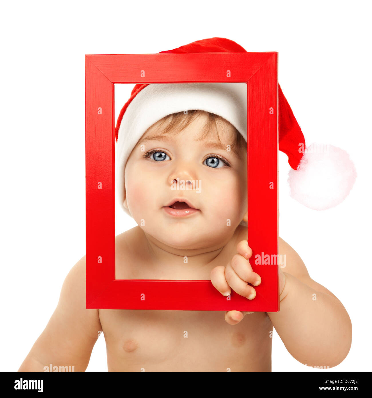 f6d97b39f557 Photo of cute baby boy wearing Santa Claus hat, closeup portrait of curious  infant looking through red Christmas frame isolated