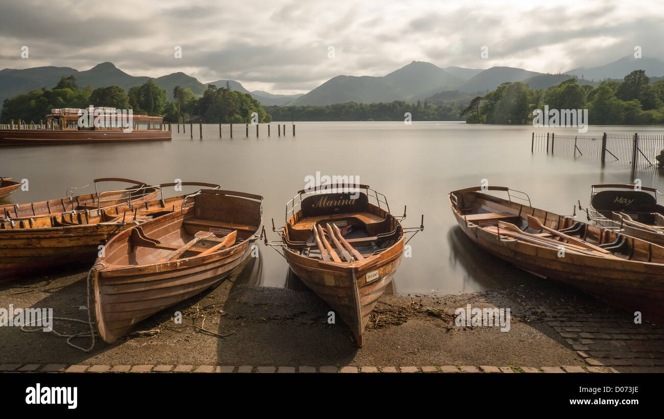 Old wooden rowing boats in the evening on the beach at Derwentwater, near Keswick, Lake District, England. - Stock Image