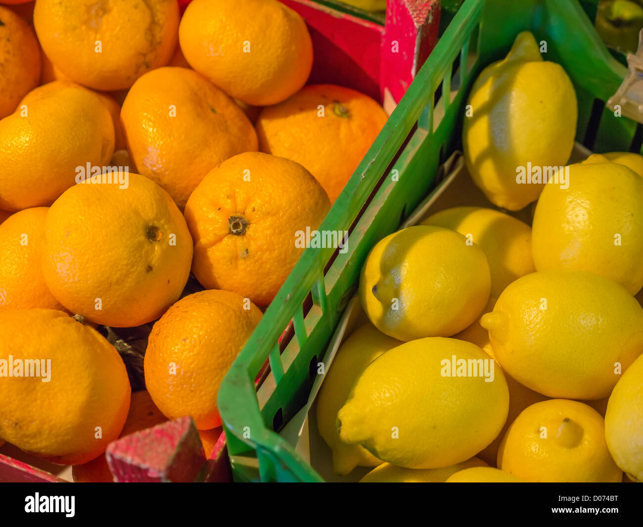 Baskets of oranges and lemons for sale in a farmers' market in Scotland. - Stock Image