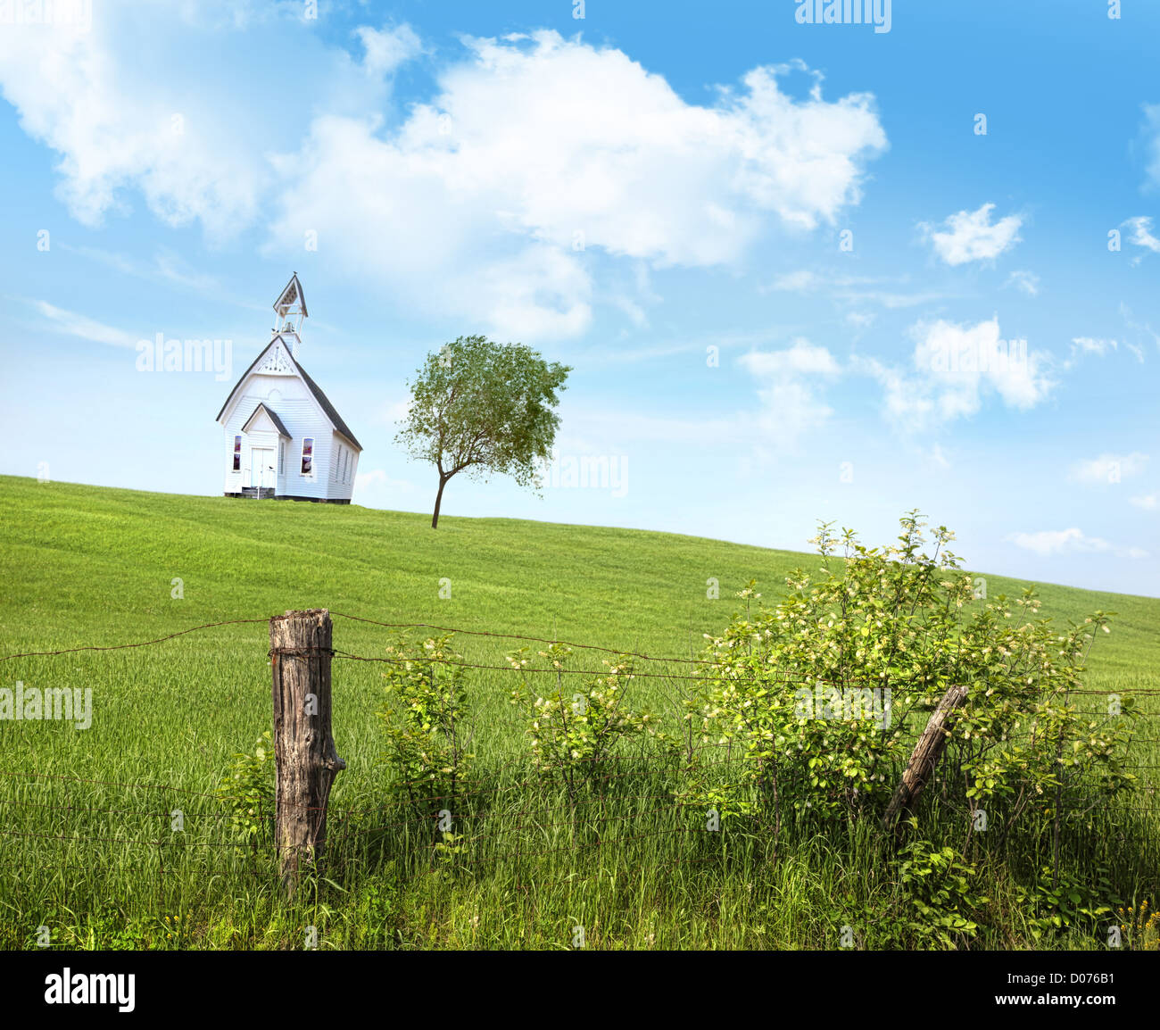 Old country school house  on a hill against a blue sky Stock Photo