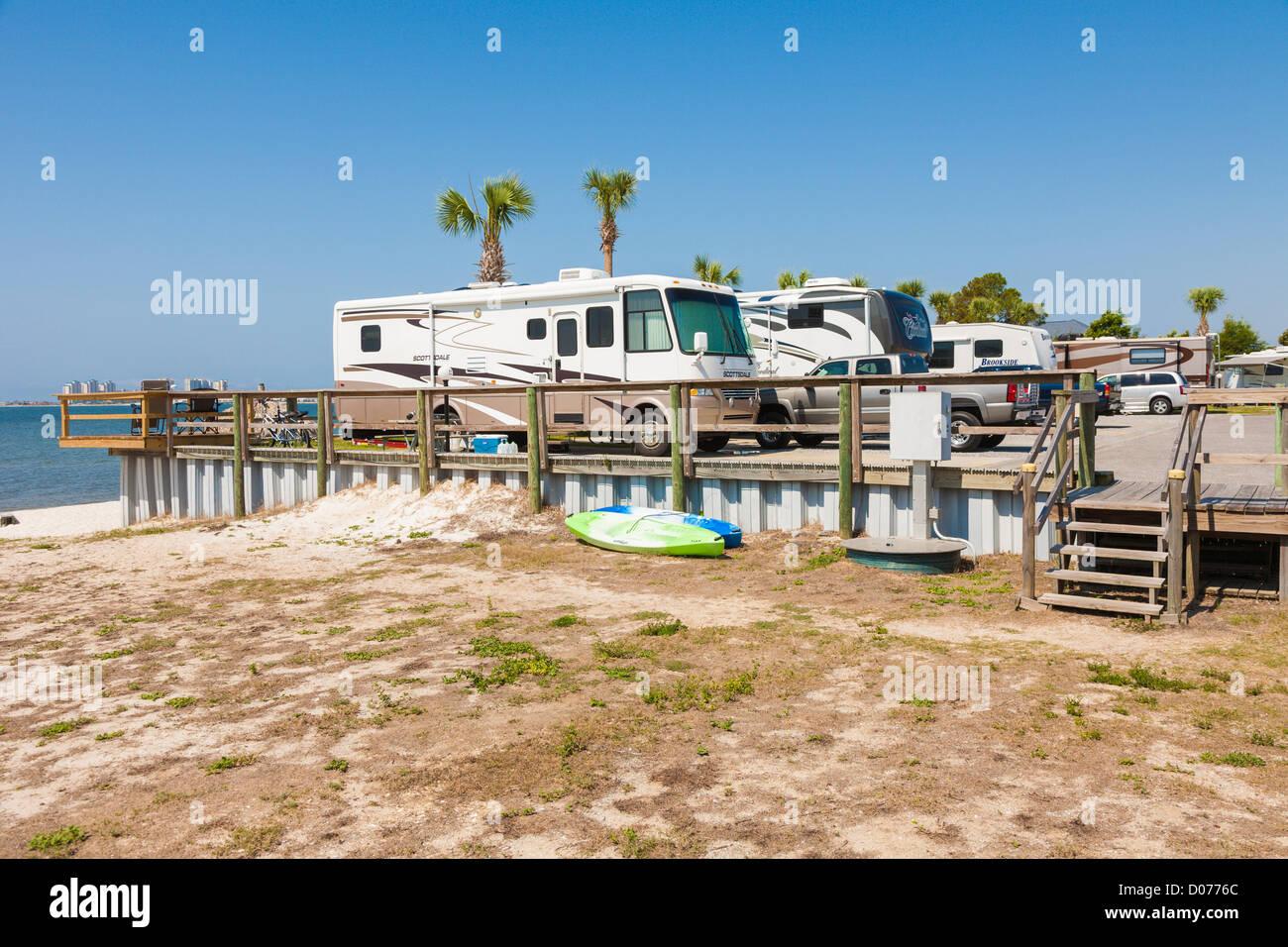 Motorhomes parked at waterfront RV resort on Santa Rosa Sound in Navarre, Florida - Stock Image
