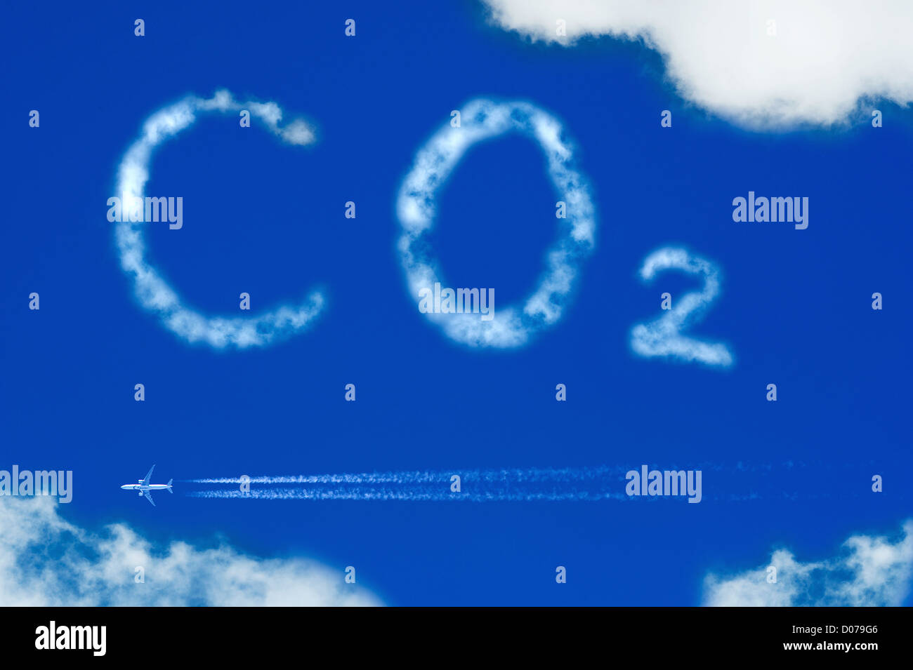 An airplane leaving a lot of CO2 behind - Stock Image